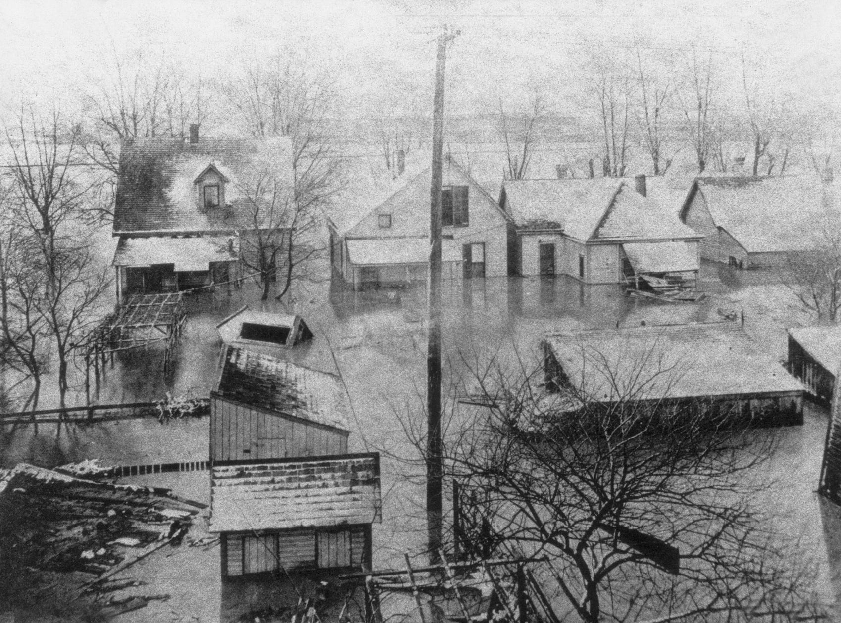 Cold and ice made the Westside a misty no-man's land after the 1913 flood. Photo from 1983 West Indianapolis Neighborhood Congress calendar of the flood which took at least 25 lives and damaged 10,000 homes.
