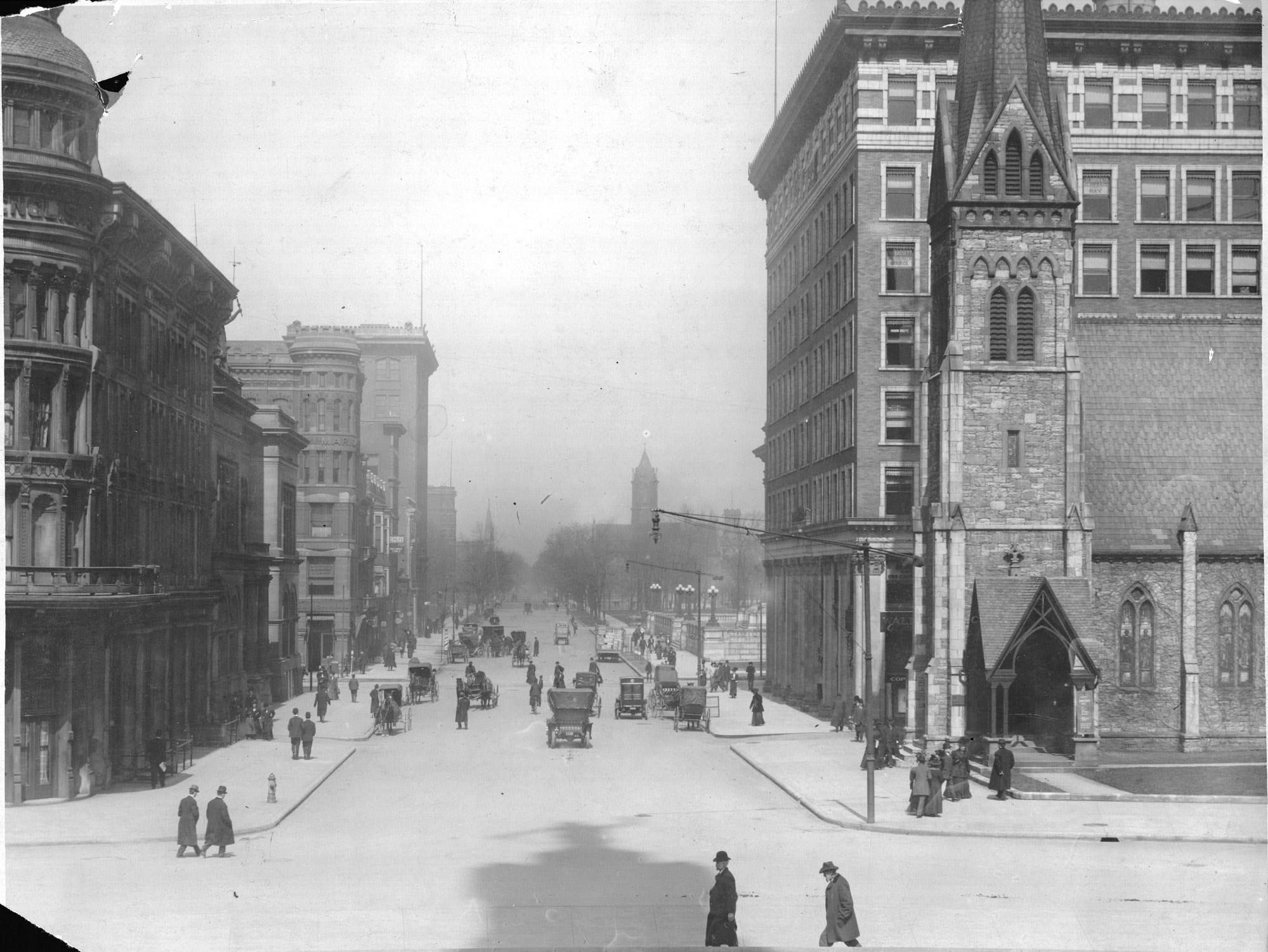 Meridian Street, looking north from the steps of the Soldiers and Sailors Monument on the Circle, circa 1910. At left is the English Hotel and at right the Christ Church Cathedral. Only a couple of motorized vehicles share Meridian Street with horse and buggies. Other identifiable buildings in the block north of Ohio Stree