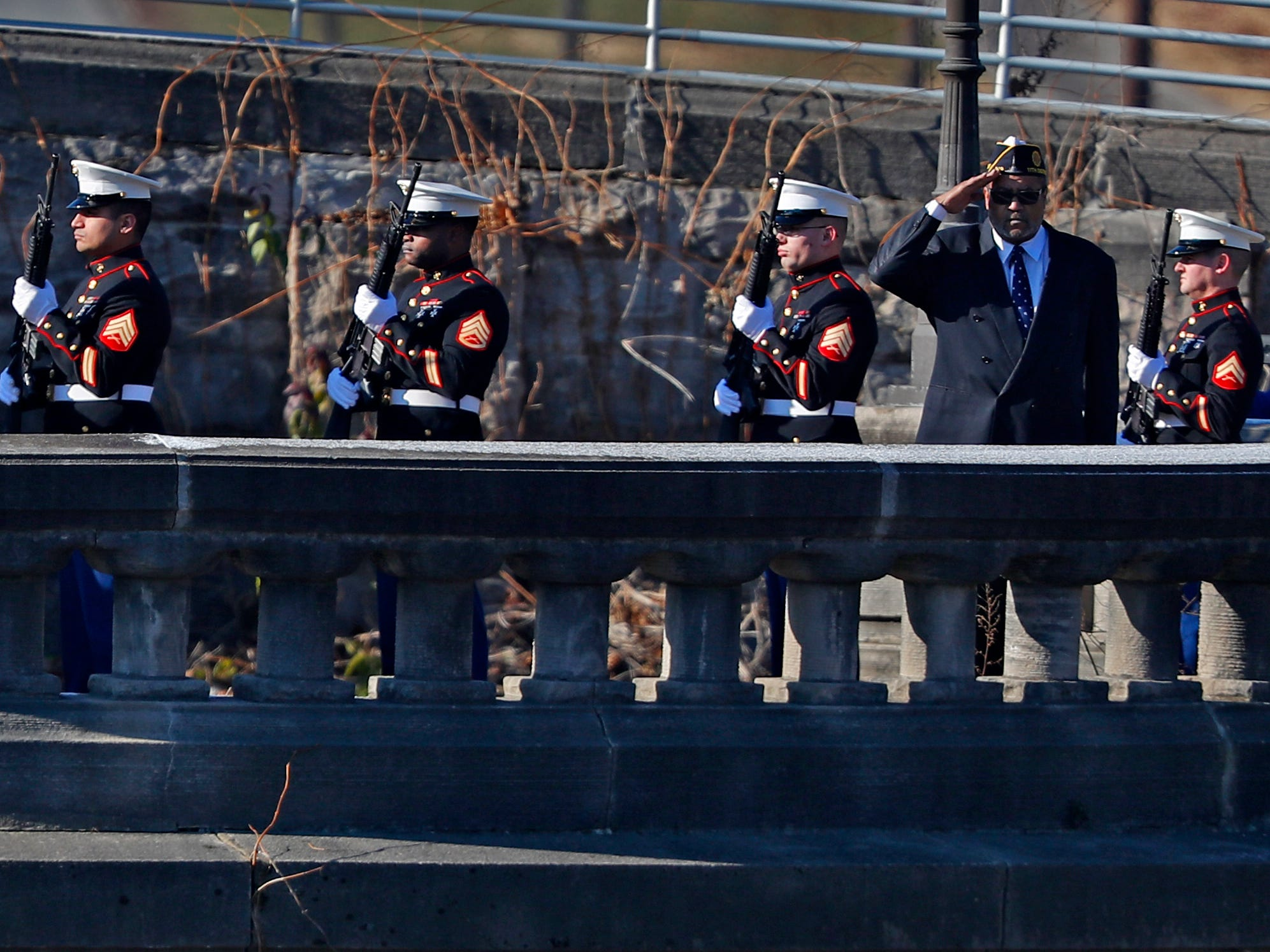 Members of the United States Marine Corps do a 21-gun rifle salute, before a wreath is tossed into White River, as part of the Pearl Harbor Day Remembrance at Riverside High School, Friday, Dec. 7, 2018.  The former Heslar Naval Armory used to host the event to remember those who died and to honor those who survived in the Dec. 7, 1941 Japanese attack on Pearl Harbor which plunged the United States into World War II.
