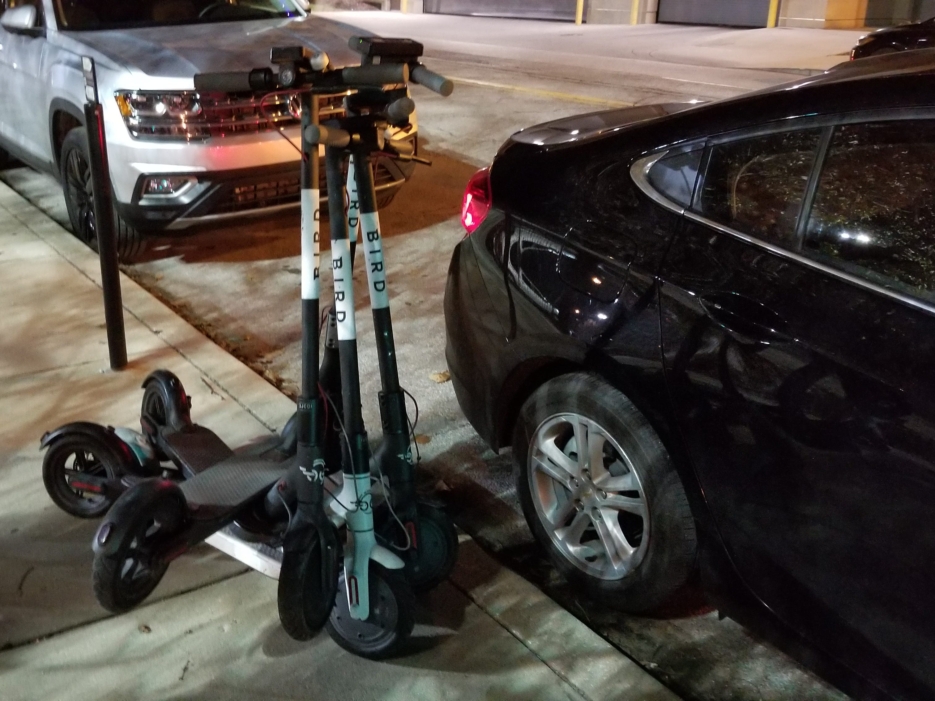 Bird scooters are stacked up as Simone Thomas collects them on Nov. 21, 2018, in Indianapolis.