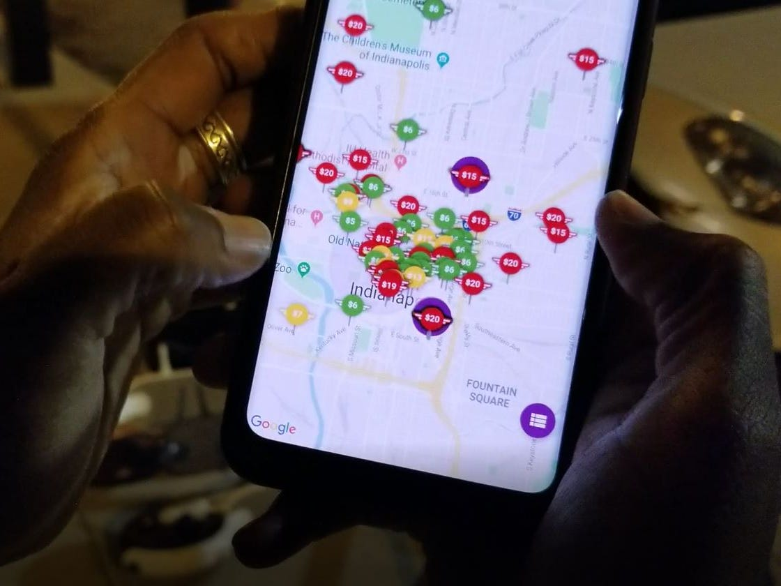 Simone Thomas looks on the map on Bird's app on Nov. 21, 2018, in Indianapolis.