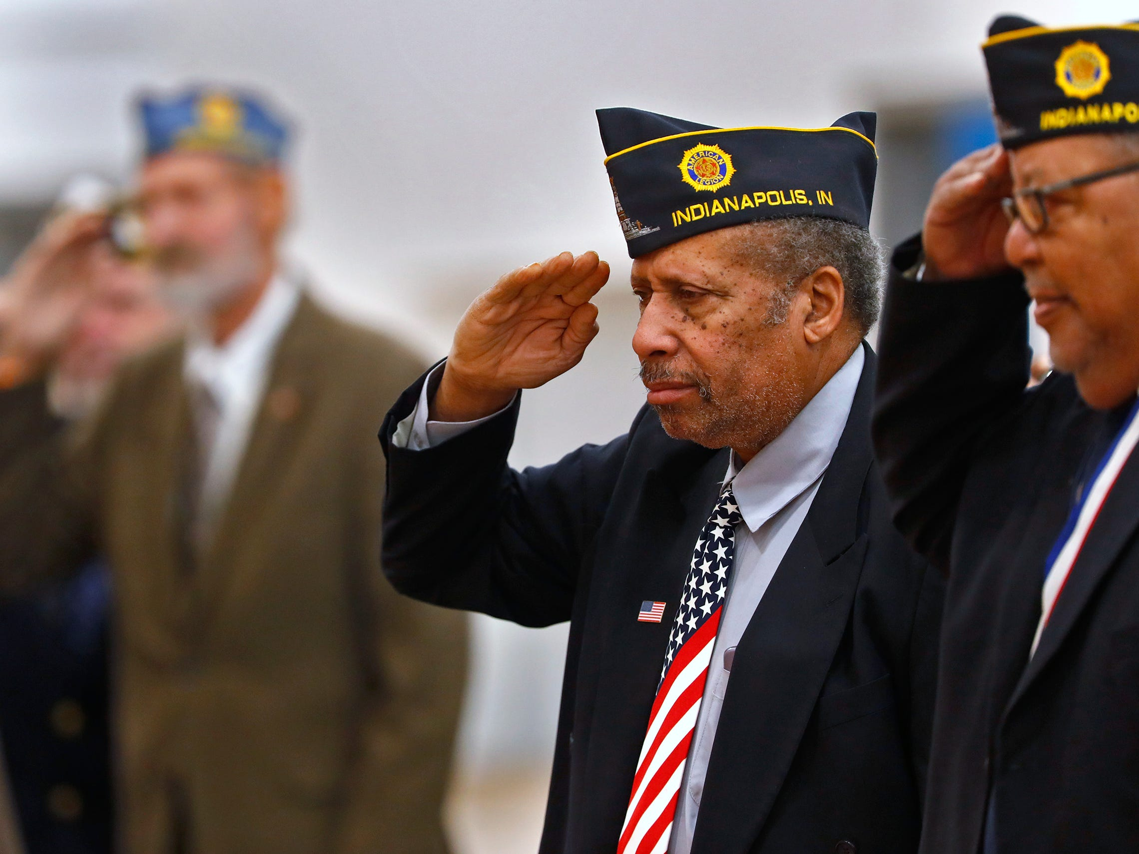 American Legion members salute as the colors are posted during the Pearl Harbor Day Remembrance at Riverside High School, Friday, Dec. 7, 2018.  The former Heslar Naval Armory used to host the event to remember those who died and to honor those who survived in the Dec. 7, 1941 Japanese attack on Pearl Harbor which plunged the United States into World War II.