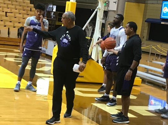 Former Kentucky coach Tubby Smith, now at High Point University, runs practice along with son G.G. Smith (right)