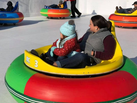 Customers ride bumper cars at the new Avon Ice Rink.