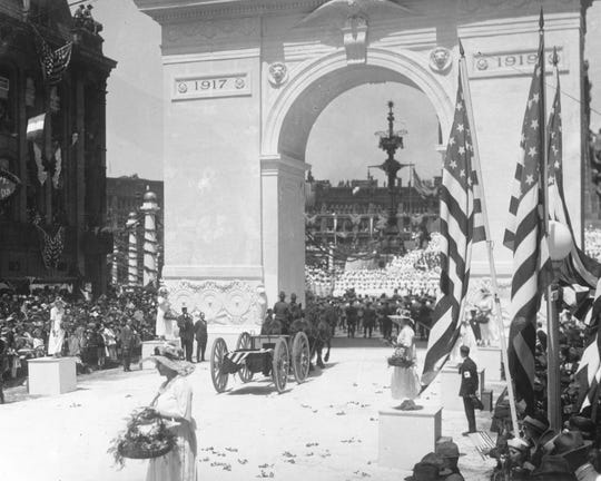 Thousands of people lined the streets in Indianapolis on May 7, 1919 to welcome home Indiana's returning World War I soldiers. Women threw flowers in the path of soldiers marching up Meridian Street to the Circle, where a living Red Cross was formed on the steps of the Soldiers and Sailors Monument. A victory arch spanned the Meridian Street entrance to the Circle. I