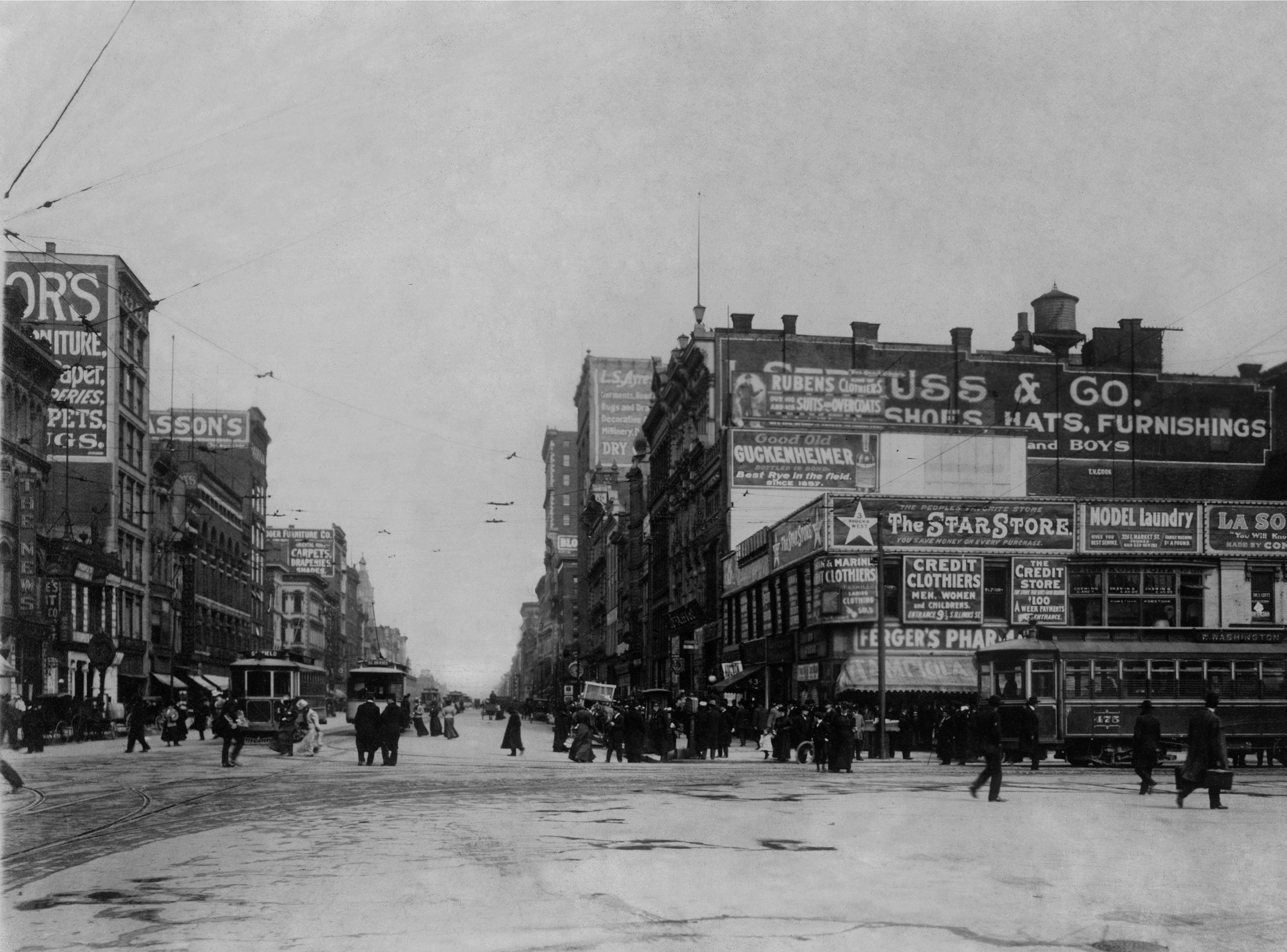 1918 Indianapolis street scene: left  (north side) are The Indianapolis News and H. P. Wasson & Co. Shown at right (south side) are L.S. Ayres & Company