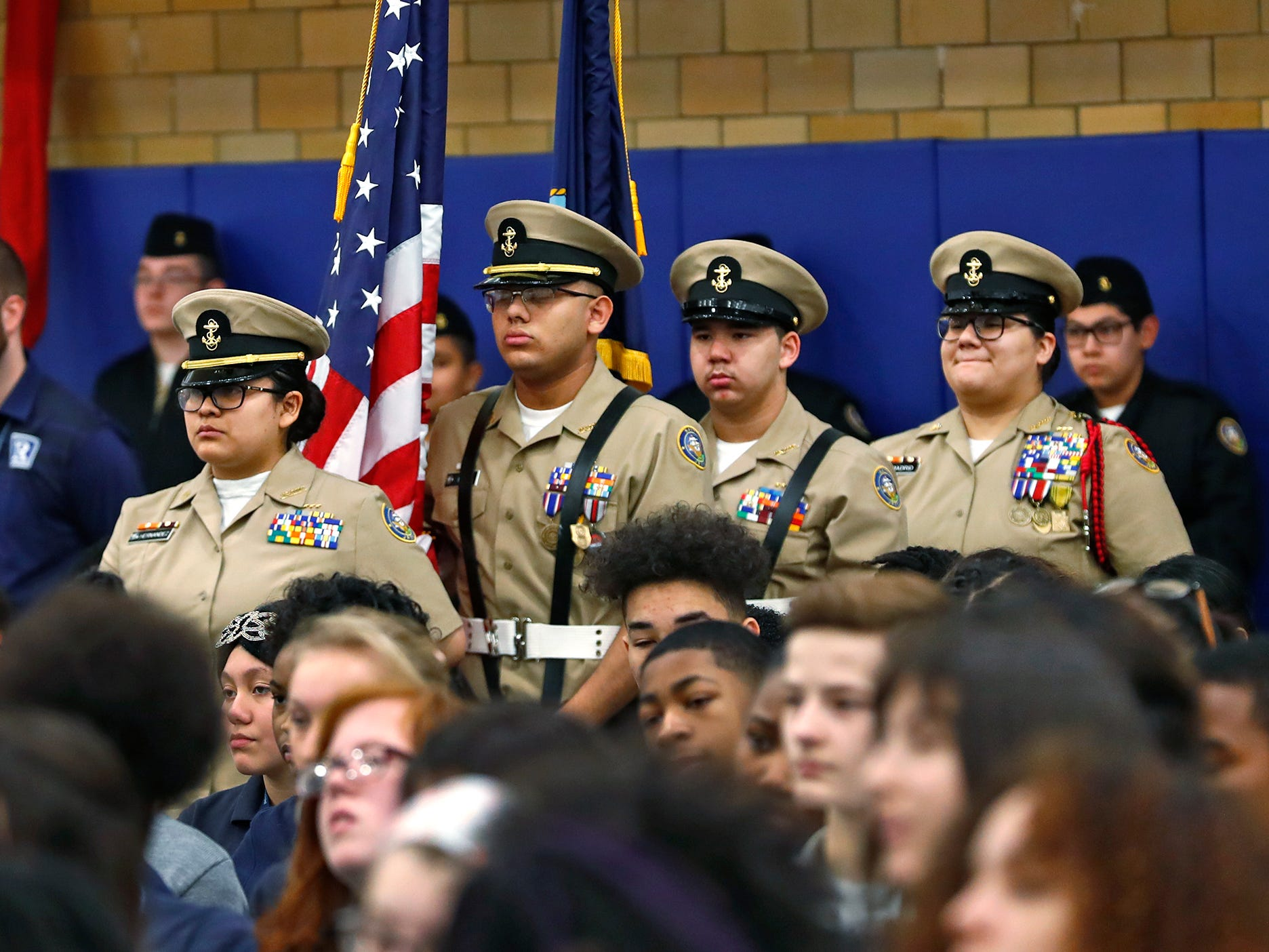 Members of the Pike High School's Junior Reserve Officer Training Corps Color Guard gets ready to Post the Colors during the Pearl Harbor Day Remembrance at Riverside High School, Friday, Dec. 7, 2018.  The former Heslar Naval Armory used to host the event to remember those who died and to honor those who survived in the Dec. 7, 1941 Japanese attack on Pearl Harbor which plunged the United States into World War II.  The Tillman H. Harpole American Legion Post 249 presented the 20th annual service,