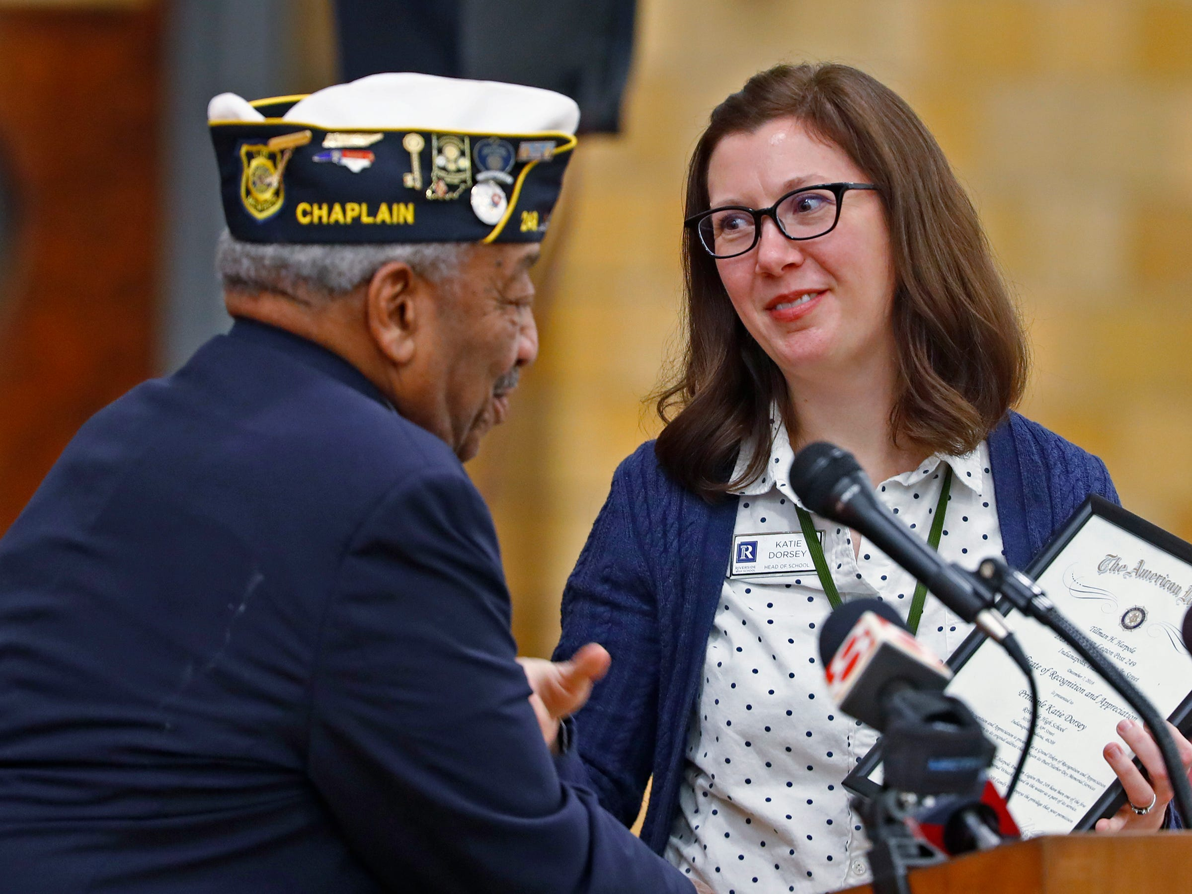 Chaplain of Indiana's 11th District of the American Legion Edward Harris Jr., left, thanks Riverside principal Katie Dorsey and gives her a certificate of recognition and appreciation, during the Pearl Harbor Day Remembrance at Riverside High School, Friday, Dec. 7, 2018.  The former Heslar Naval Armory used to host the event to remember those who died and to honor those who survived in the Dec. 7, 1941 Japanese attack on Pearl Harbor which plunged the United States into World War II.