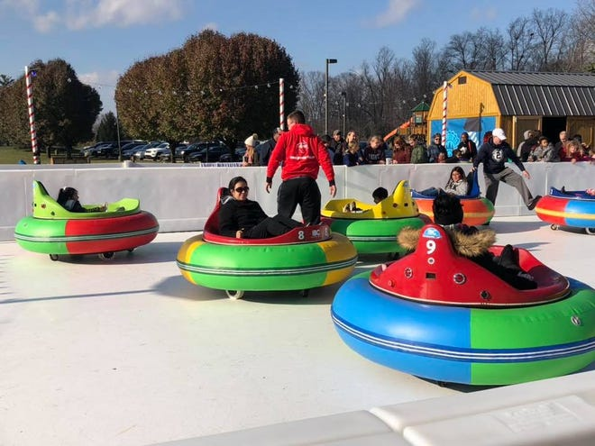 Customers ride the new bumper cars at the Avon Ice Rink.