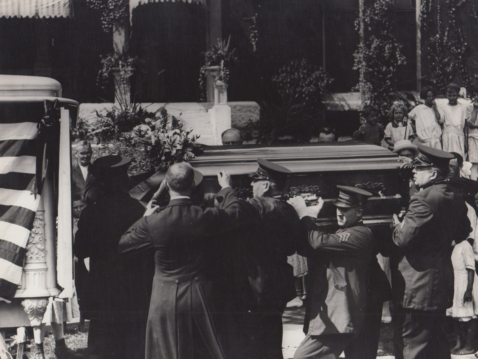 Members of the Indianapolis police department place the casket of James Whitcomb Riley into the hearse, July 25, 1916