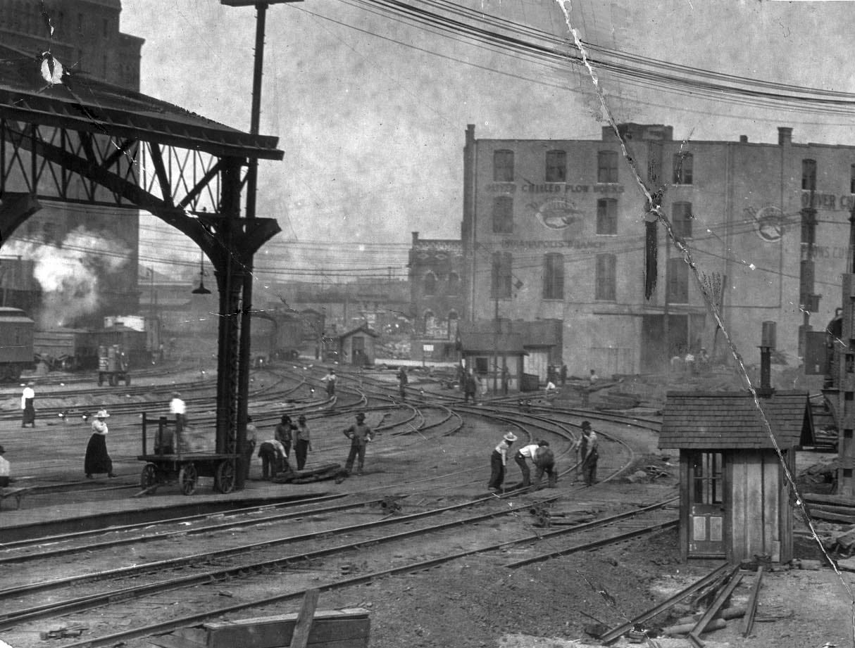 Workers for the Indianapolis Union Railway Co. are shown elevating the Union railway tracks around Union Station and constructing a steel train shed in this photo, taken July 26, 1916.