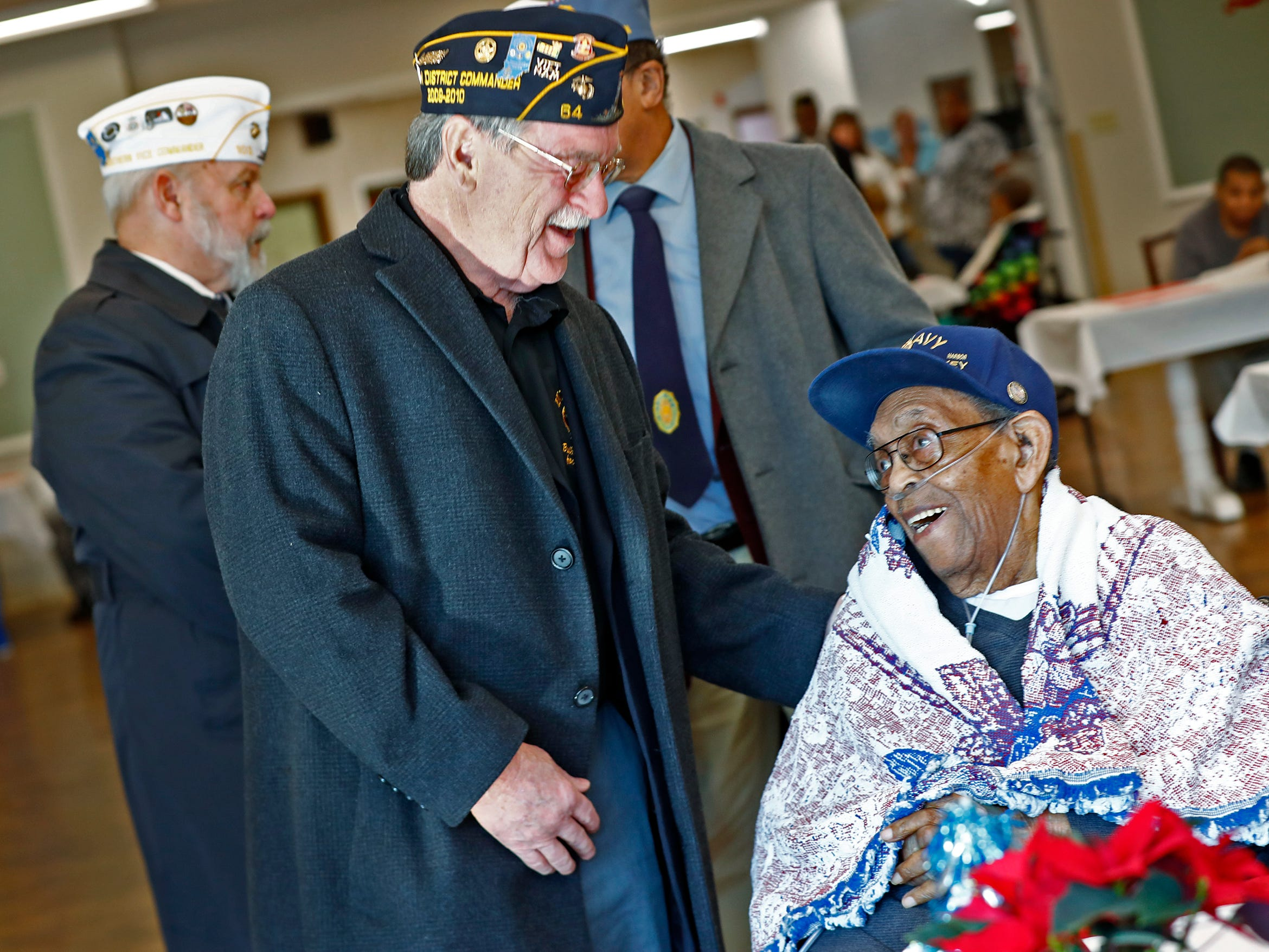 American Legion's Kenny Cooper, left, speaks with Pearl Harbor attack survivor William Harvey, right, at the Alpha Home where he lives, Friday, Dec. 7, 2018.  Harvey was unable to attend a Pearl Harbor Day Remembrance at Riverside High School, so several members with The American Legion came to visit him.  The former Heslar Naval Armory, now Riverside High School, used to host the event to remember those who died and to honor those who survived in the Dec. 7, 1941 Japanese attack on Pearl Harbor which plunged the United States into World War II.  This year, the event was brought back.  There was also a 21-gun salute, taps played, and a wreath tossing ceremony on the banks of the White River adjacent to the school.