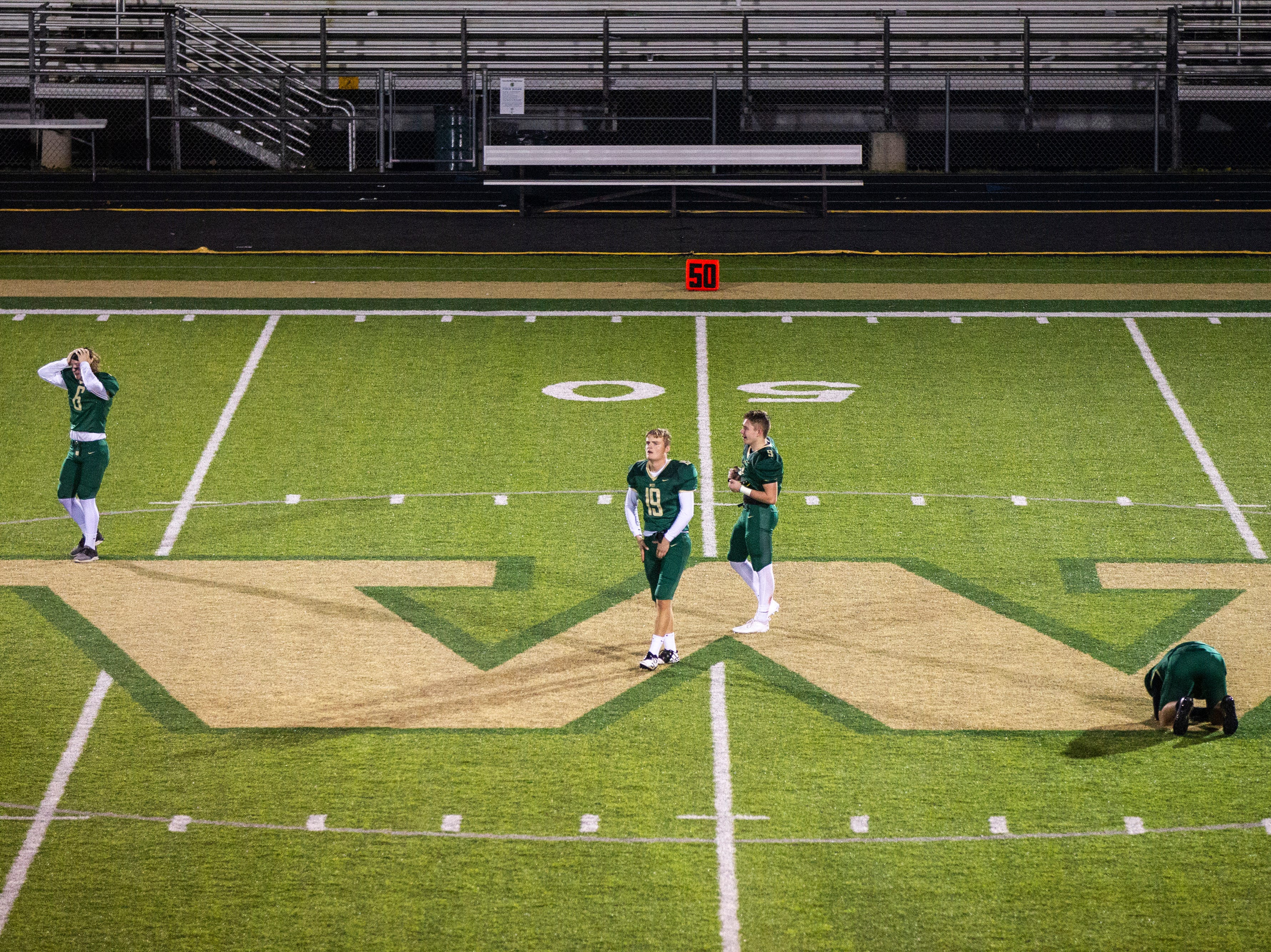 Iowa City West players reflect at midfield after a Class 4A quarter final football game on Friday, Nov. 2, 2018, at Trojan Field in Iowa City.