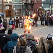Hilby the Skinny German Juggle Boy entertains the crowds on Main Street at Trumansburg's Winterfest.