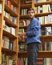 Kyle Crockett works at Lemuria book in Jackson to supplement his income earned as a teacher. Thursday, Dec. 6, 2018.