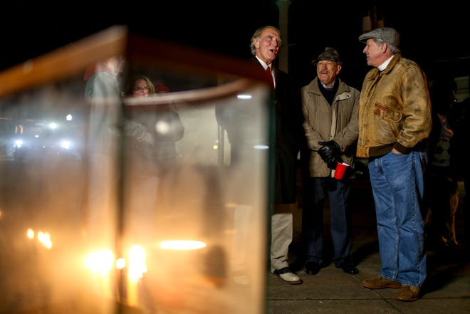Members of the Congregation B'nai Israel speak with Jackson Mayor Jerry Gist during the first public Hanukkah Menorah Lighting at Anderson Park in Jackson, Tenn., on Thursday, Dec. 6, 2018.