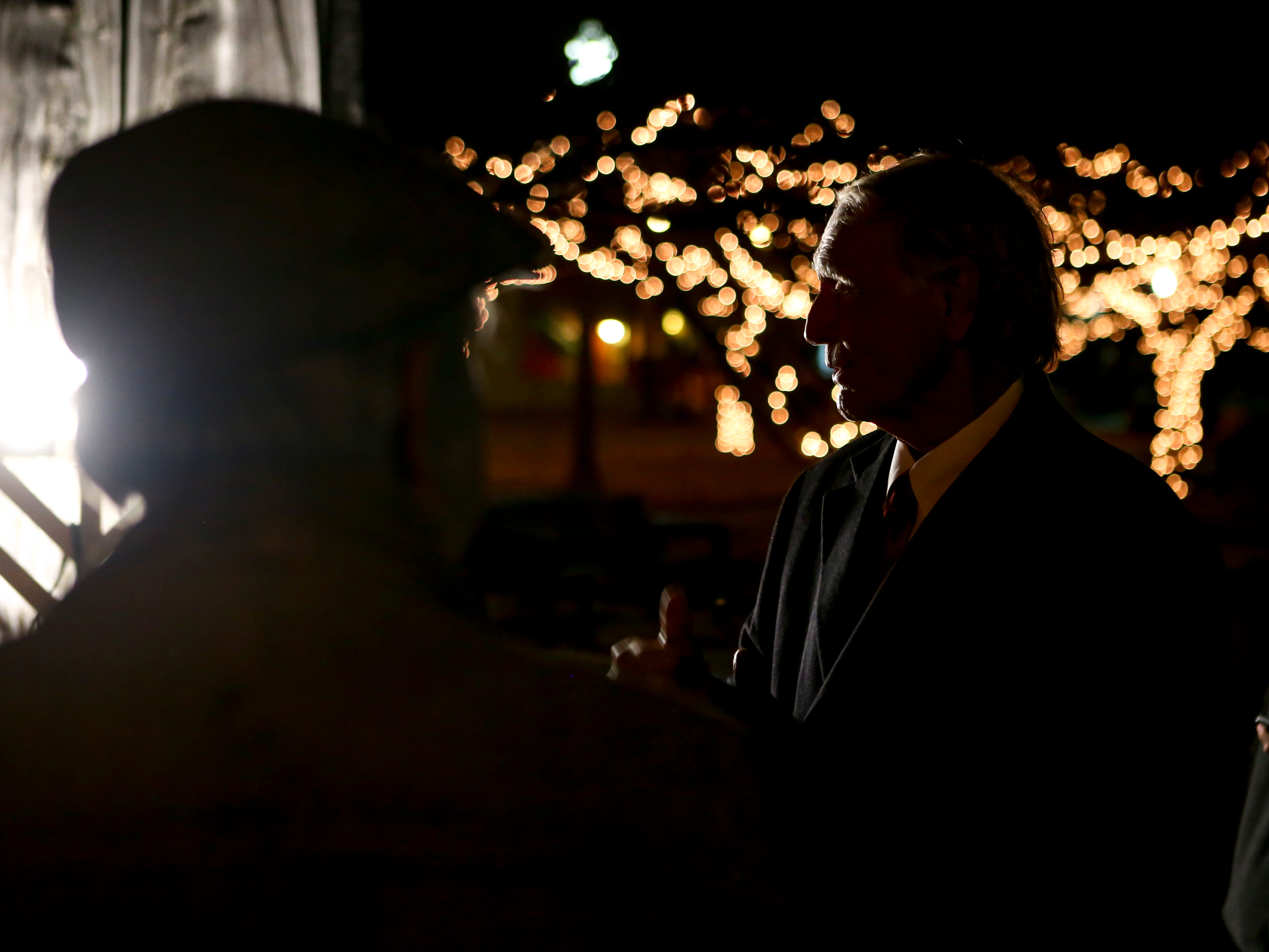 Jackson City Mayor Jerry Gist looks on after the lighting ceremony of the menorah during the first public Chanukah Menorah Lighting at Anderson Park in Jackson, Tenn., on Thursday, Dec. 6, 2018.