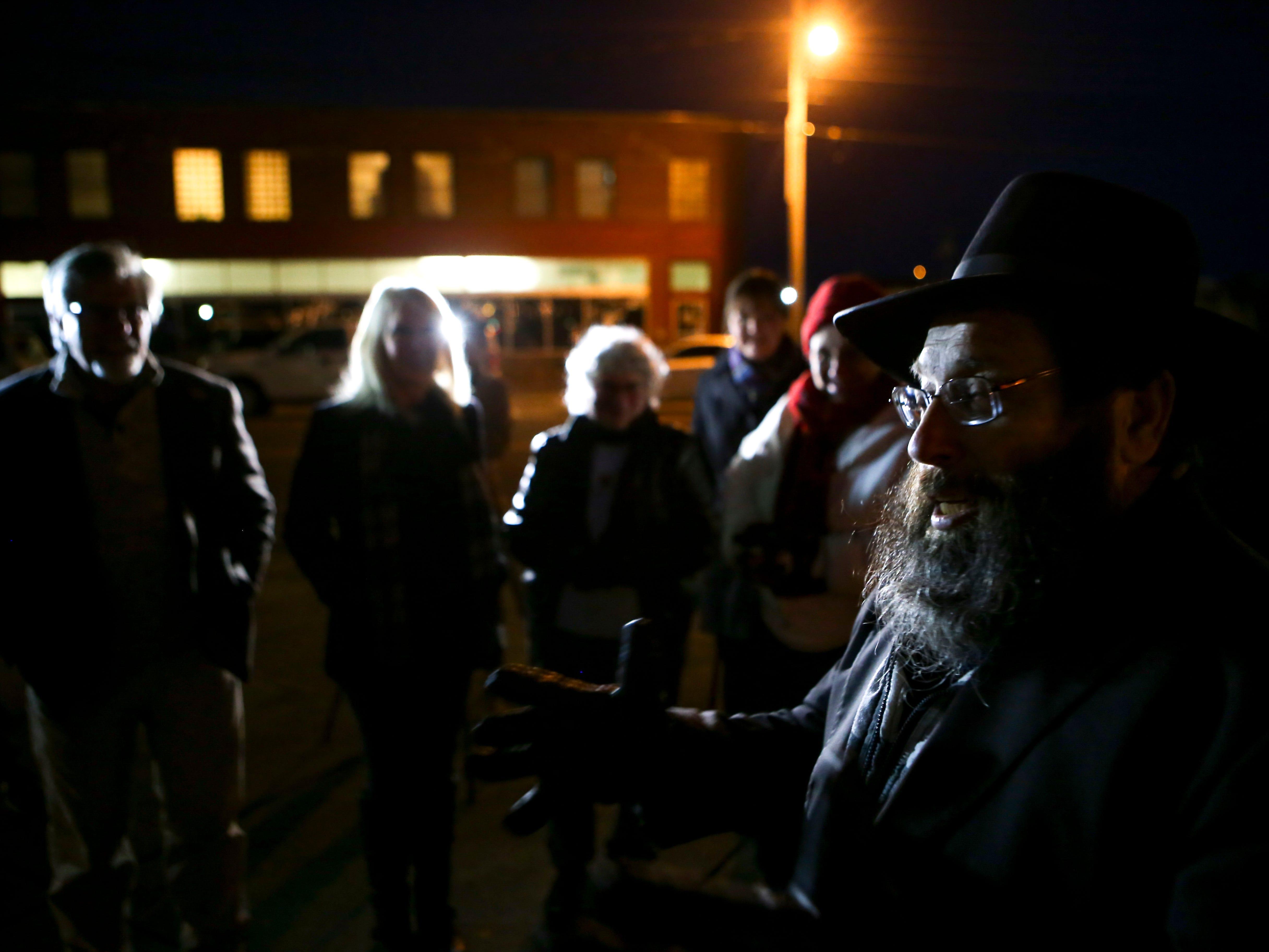Rabbi Yankel Ginsburg shares the story of the importance of Hanukkah during the first public Hanukkah Menorah Lighting at Anderson Park in Jackson, Tenn., on Thursday, Dec. 6, 2018.