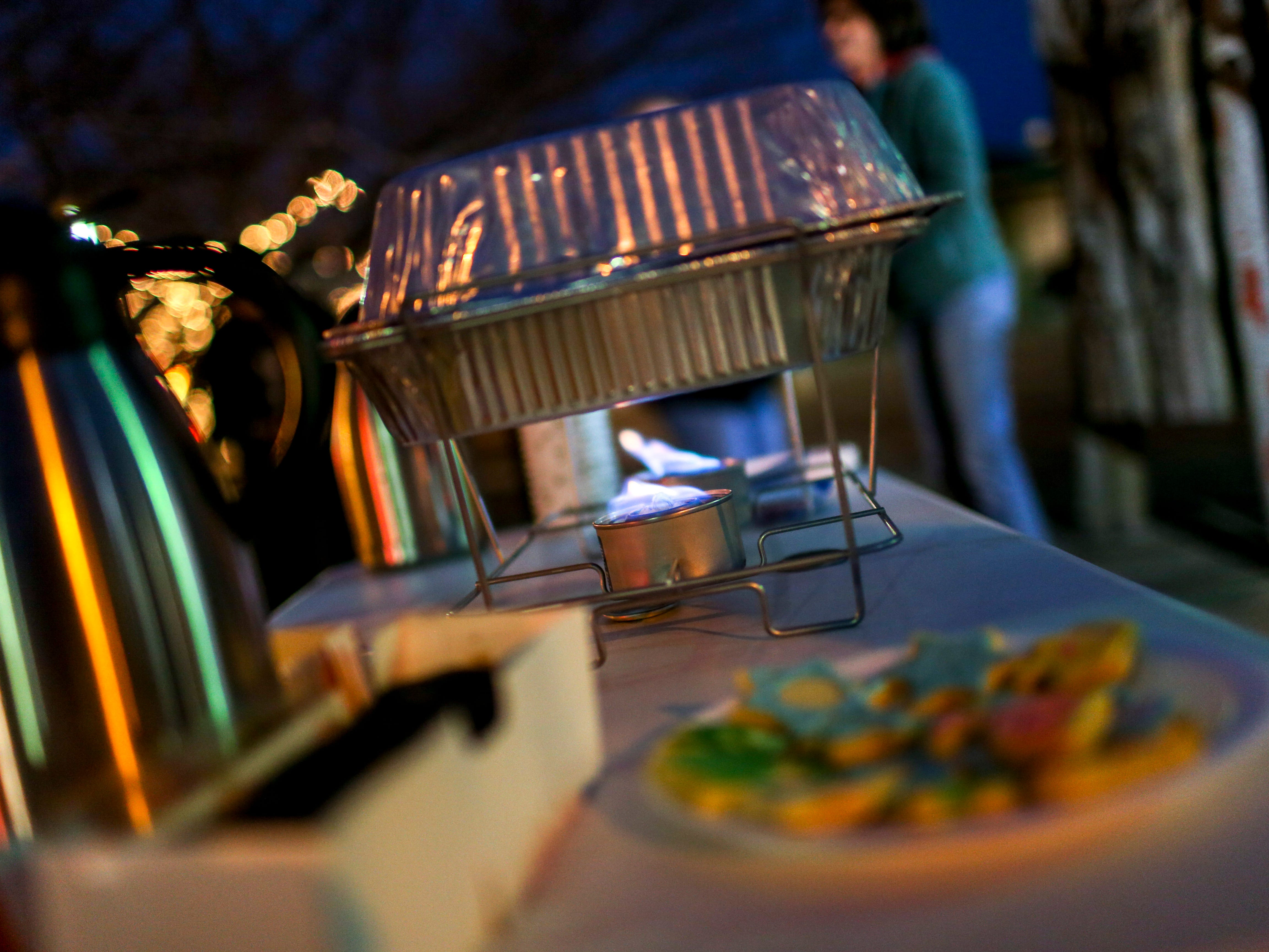 A table providing traditional Jewish snacks and hot cider was presented by Rabbi Yankel Ginsburg during the first public Hanukkah Menorah Lighting at Anderson Park in Jackson, Tenn., on Thursday, Dec. 6, 2018.