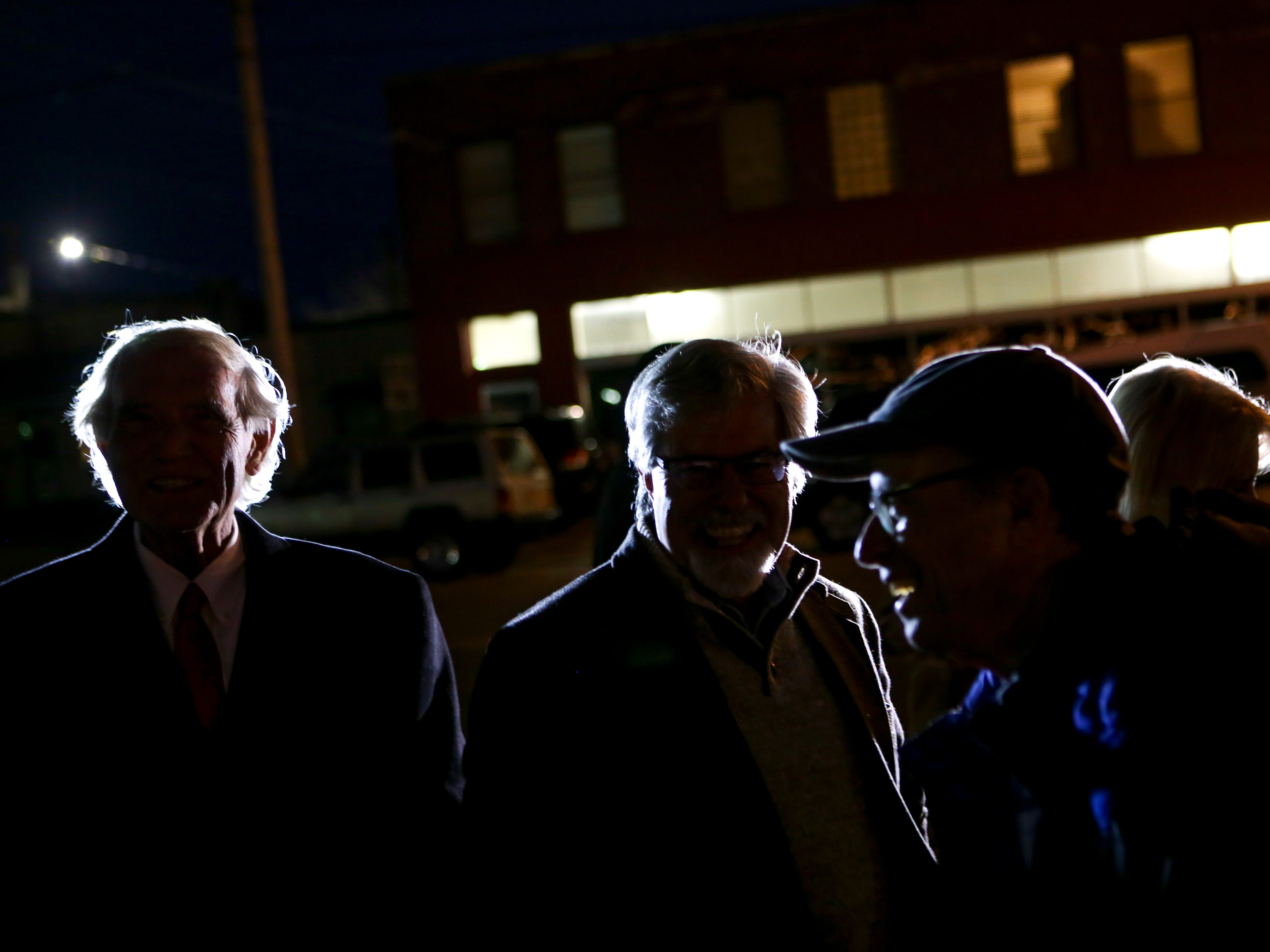 Visitors chat with Jackson City Mayor Jerry Gist, left, before the lighting ceremony during the first public Chanukah Menorah Lighting at Anderson Park in Jackson, Tenn., on Thursday, Dec. 6, 2018.