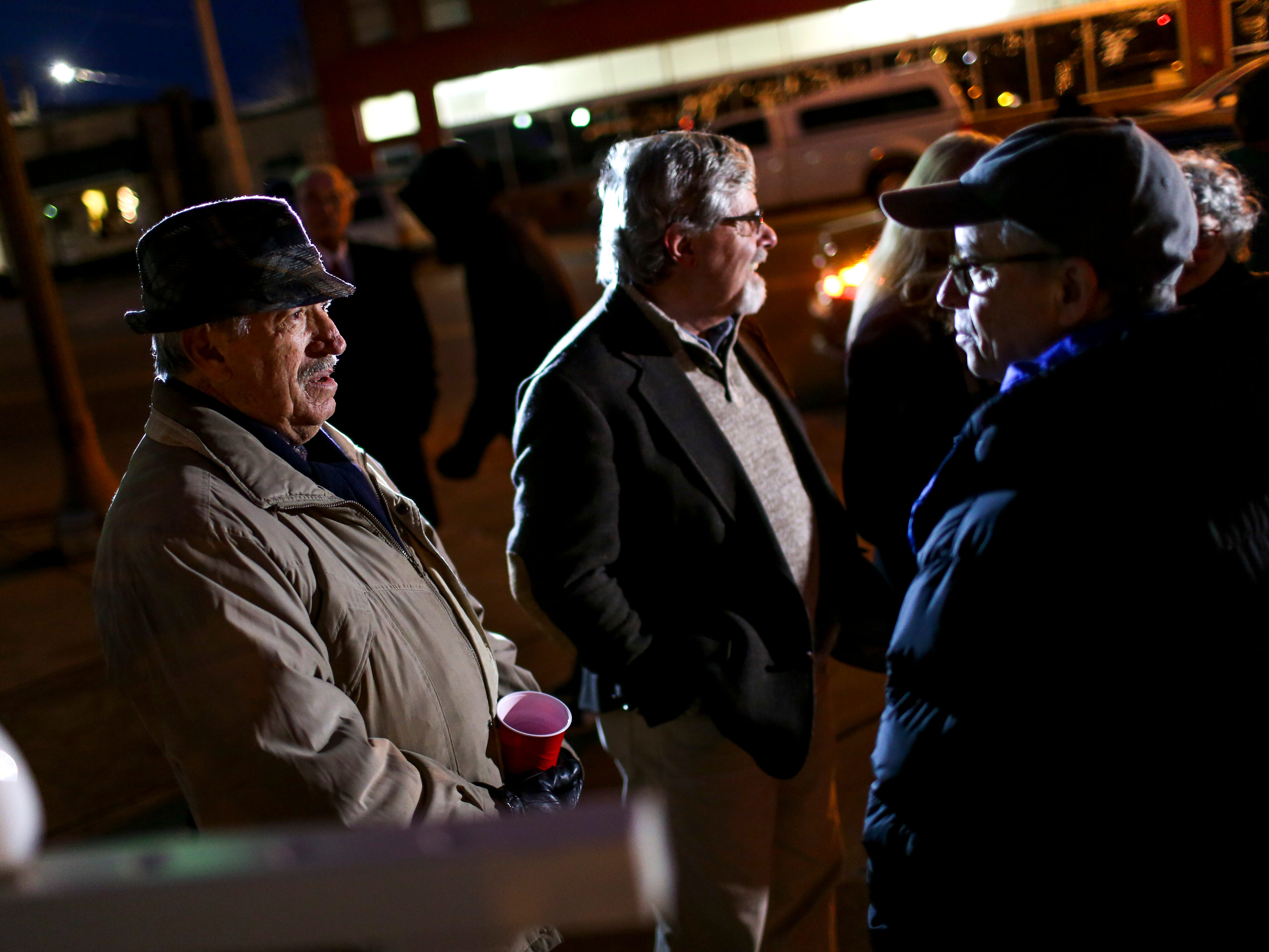 Members of the B'nai congregation mingle and chat with others during the first public Chanukah Menorah Lighting at Anderson Park in Jackson, Tenn., on Thursday, Dec. 6, 2018.