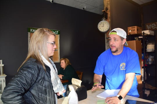 Lynsey Emert places an advance order with owner Ryan Wells at Beaver's Dough Joe Wednesday, Dec. 5.