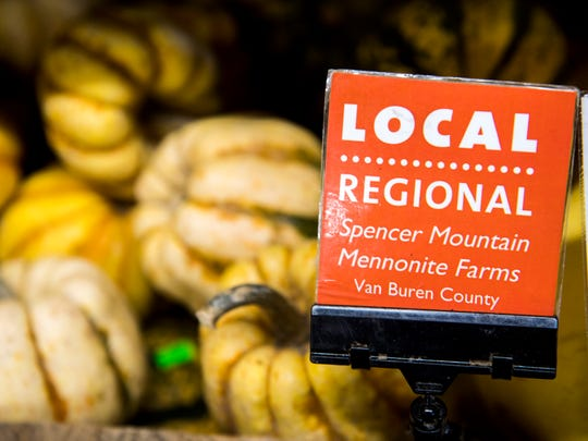 """Red tags labeled with """"LOCAL"""" tell customers where in the region products are from at Three Rivers Market in the Happy Holler area of Knoxville."""