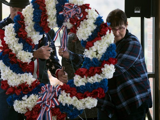 Linda Haddock, daughter of Knoxville area Pearl Harbor survivor, John Edward Maxey, participates in a wreath presentation during the Pearl Harbor Remembrance Day services at Tennessee Veterans Cemetery on Friday, December 7, 2018.