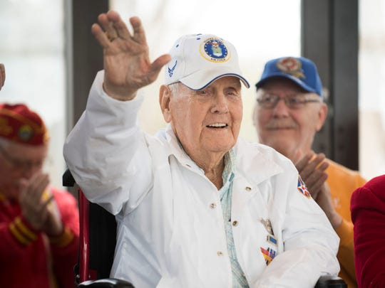 Pearl Harbor survivor Durwood Swanson waves as he is introduced to the crowd gathered for the Pearl Harbor Remembrance Day services at Tennessee Veterans Cemetery on Friday, December 7, 2018.