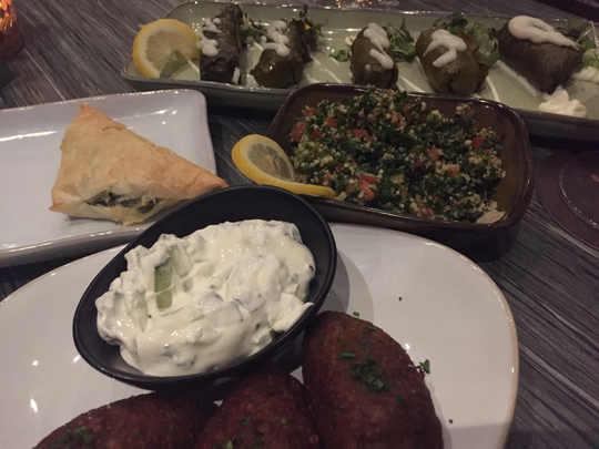 Offerings at Kefi include, from front,  baked kibbeh, spanakopita, tabbouleh and dolmades.