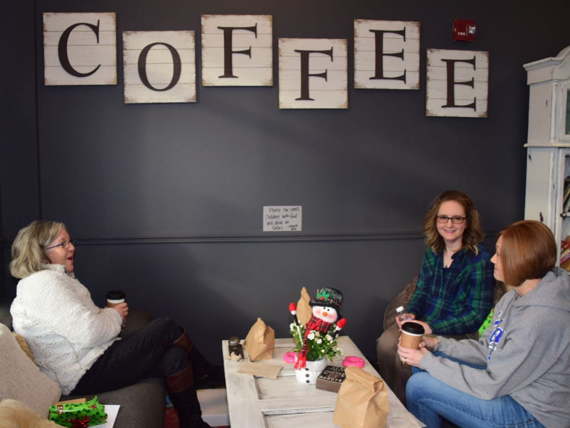 """Melanie McNutt, left, Brandy Rains, and Keri Bedsole enjoy coffee and doughnuts at Beaver's Dough Joe Wednesday, Dec. 5. """"I just love this place. We waited for the new business crowd to die down before we came. We'll definitely be back,"""" said Bedsole."""