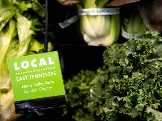 "Green tags labeled with ""LOCAL"" tell customers where in East Tennessee products are from at Three Rivers Market in the Happy Holler area of Knoxville."