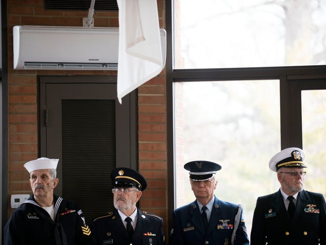 Members of the East Tennessee Veterans Honor Guard, from left, Herb Kraehmer, Sgt. A.J. Johnson, Sgt. Jack Bradshaw, and Col. Mark Kohring attend the American Legion Post 2's Pearl Harbor Remembrance Day services at Tennessee Veterans Cemetery on Friday, December 7, 2018.