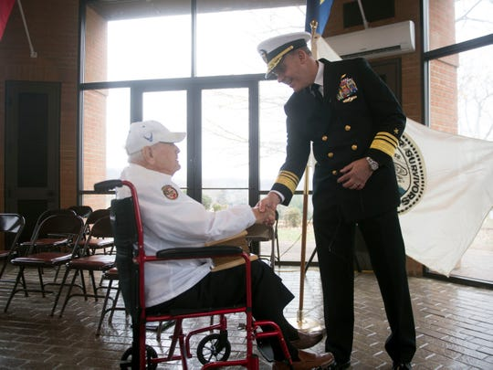 Vice Adm. Kendall Card greets Pearl Harbor survivor Durwood Swanson at the Pearl Harbor Remembrance Day services at Tennessee Veterans Cemetery on Friday, December 7, 2018.