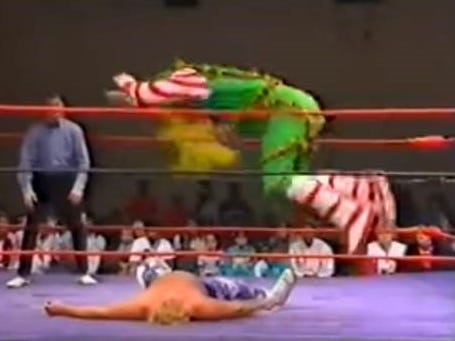 In this screenshot from a 1992 USWA match, Glenn Jacobs (top) wrestles as the Christmas Creature prior to becoming the Kane character in the WWF.