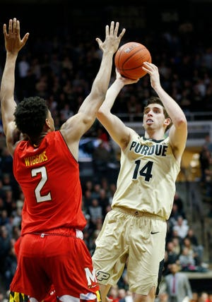Ryan Cline of Purdue with a shot over Aaron Wiggins of Maryland Thursday, December 6, 2018, at Mackey Arena. Purdue defeated Maryland 62-60.