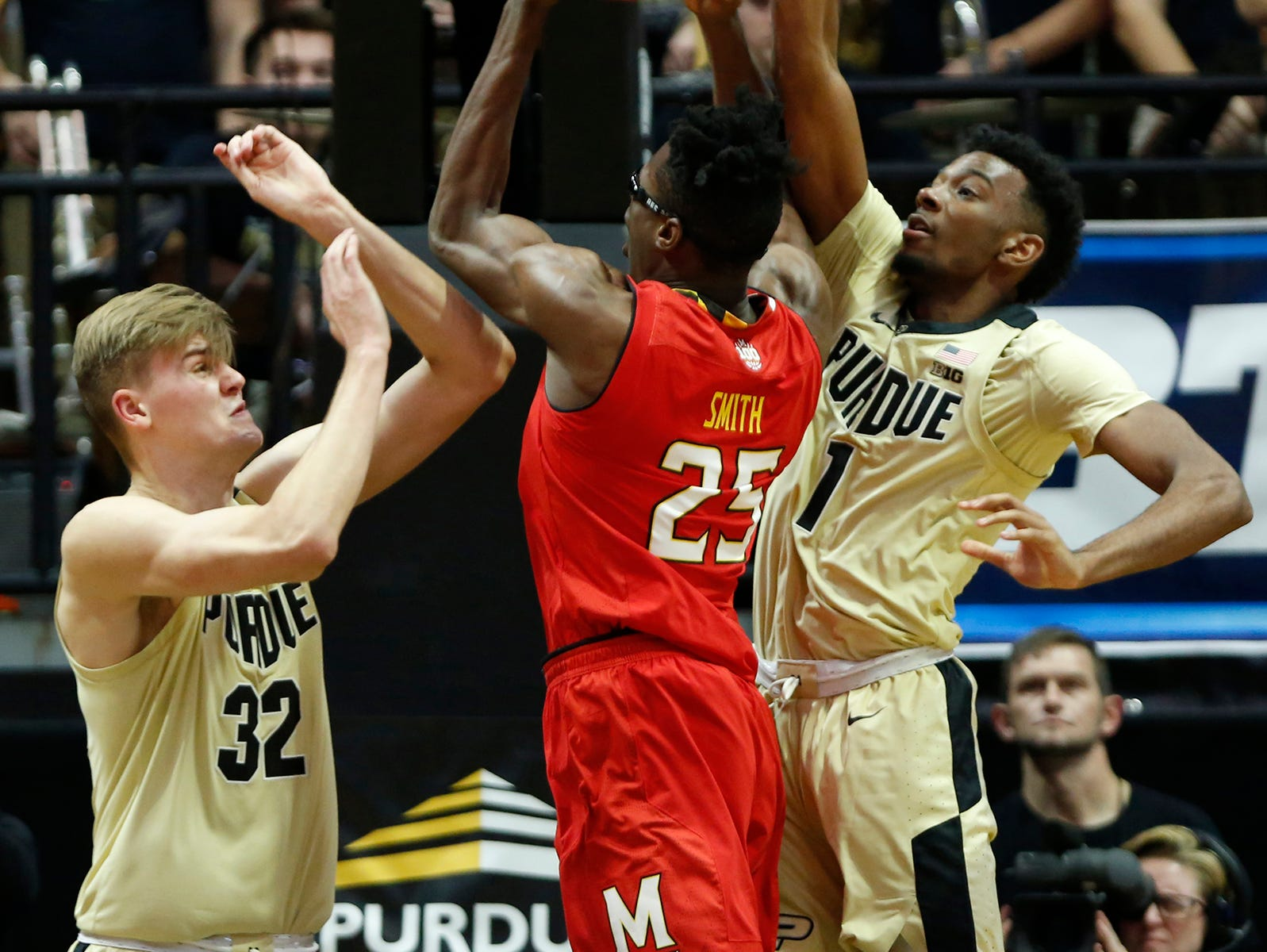 Matt Haarms and Aaron Wheeler of Purdue defend a shot at the basket by Jalen Smith of Maryland Thursday, December 6, 2018, at Mackey Arena. Purdue defeated Maryland 62-60.