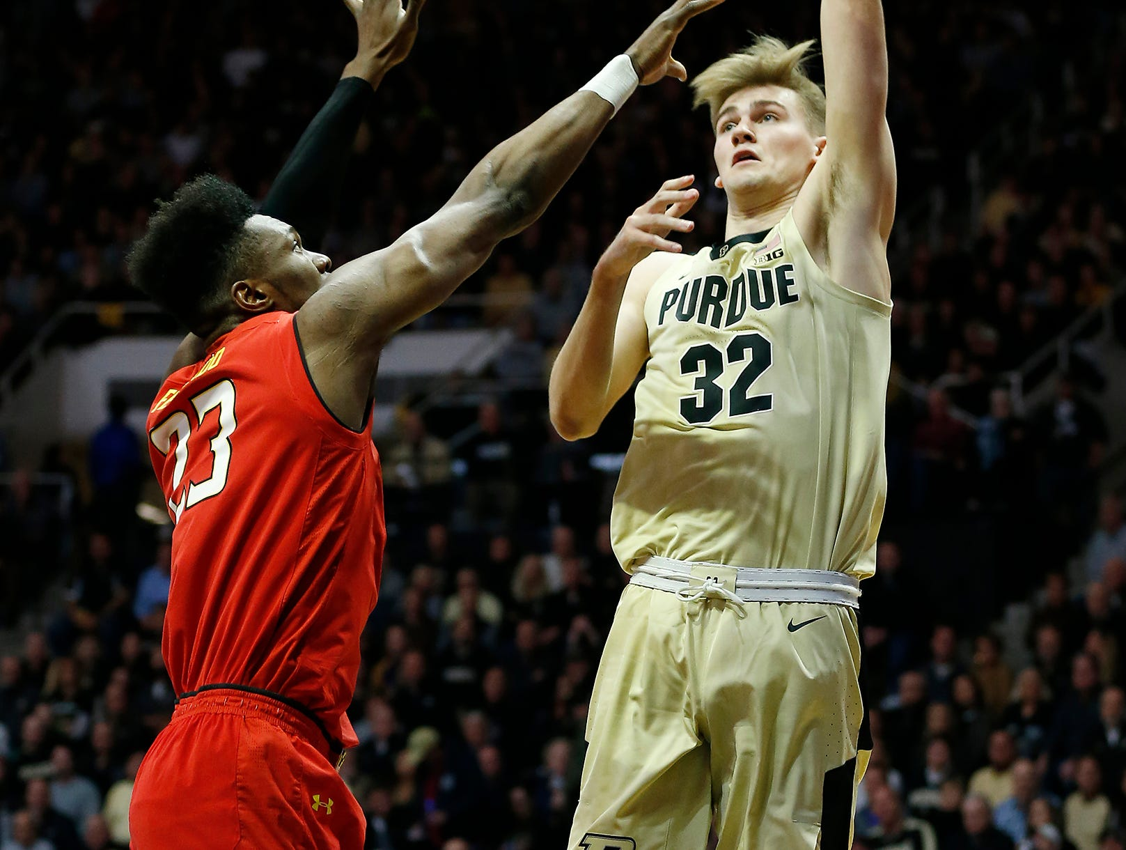 Matt Haarms of Purdue with a shot over Bruno Fernando of Maryland Thursday, December 6, 2018, at Mackey Arena.