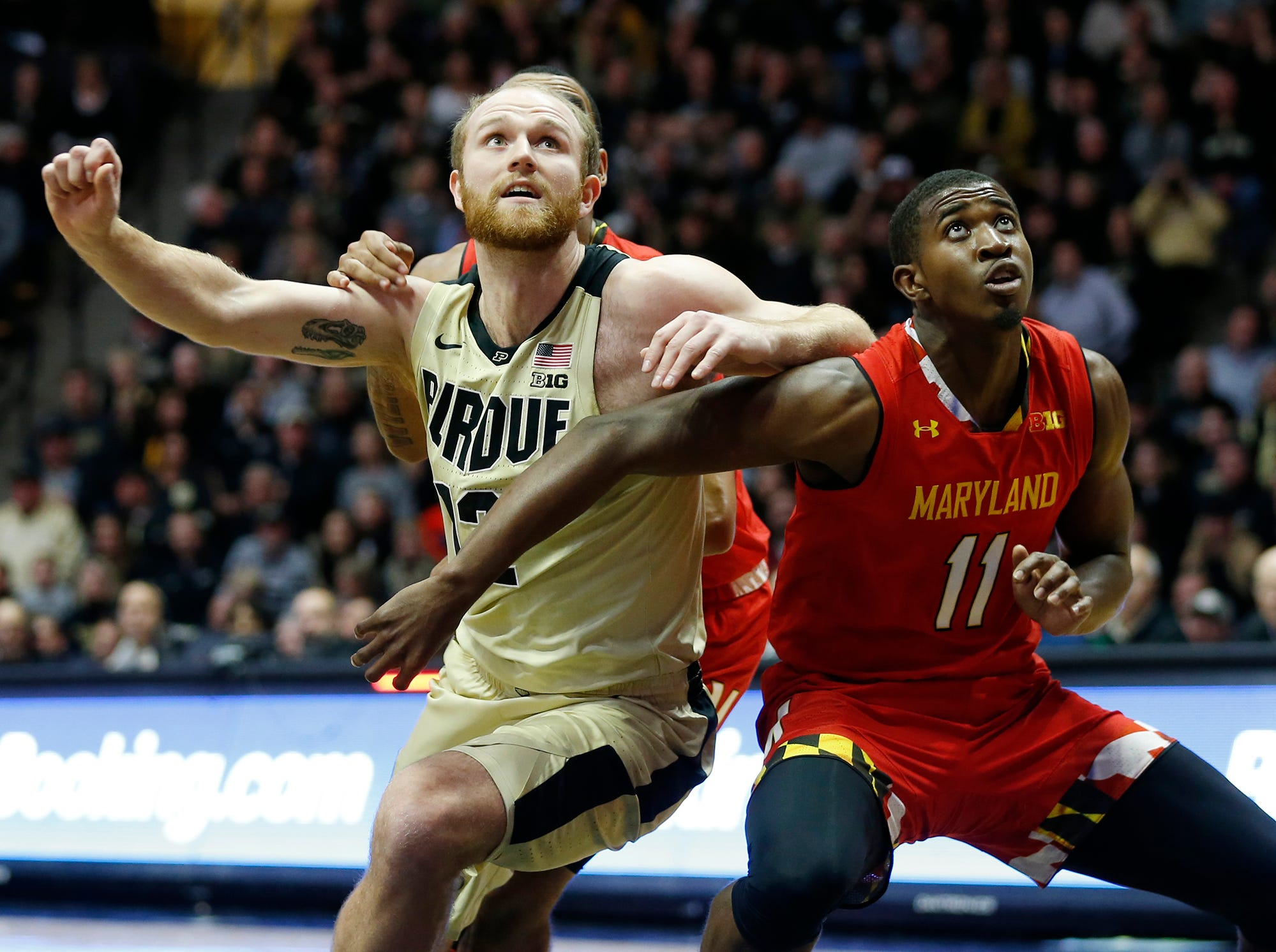 Evan Boudreaux of Purdue wrestles with Darryl Morsell of Maryland for position Thursday, December 6, 2018, at Mackey Arena. Purdue defeated Maryland 62-60.
