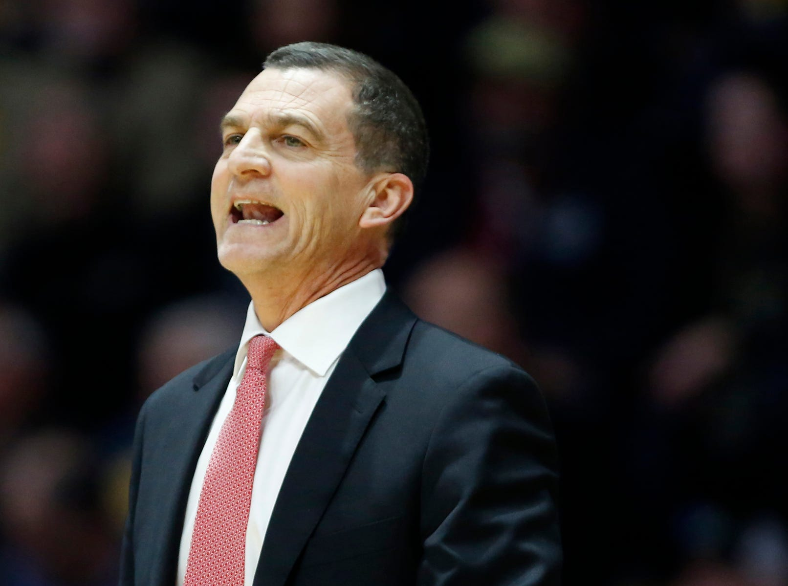 Maryland head coach Mark Turgeon shouts instructions to the Terrapins as they battle Purdue Thursday, December 6, 2018, at Mackey Arena. Purdue defeated Maryland 62-60.