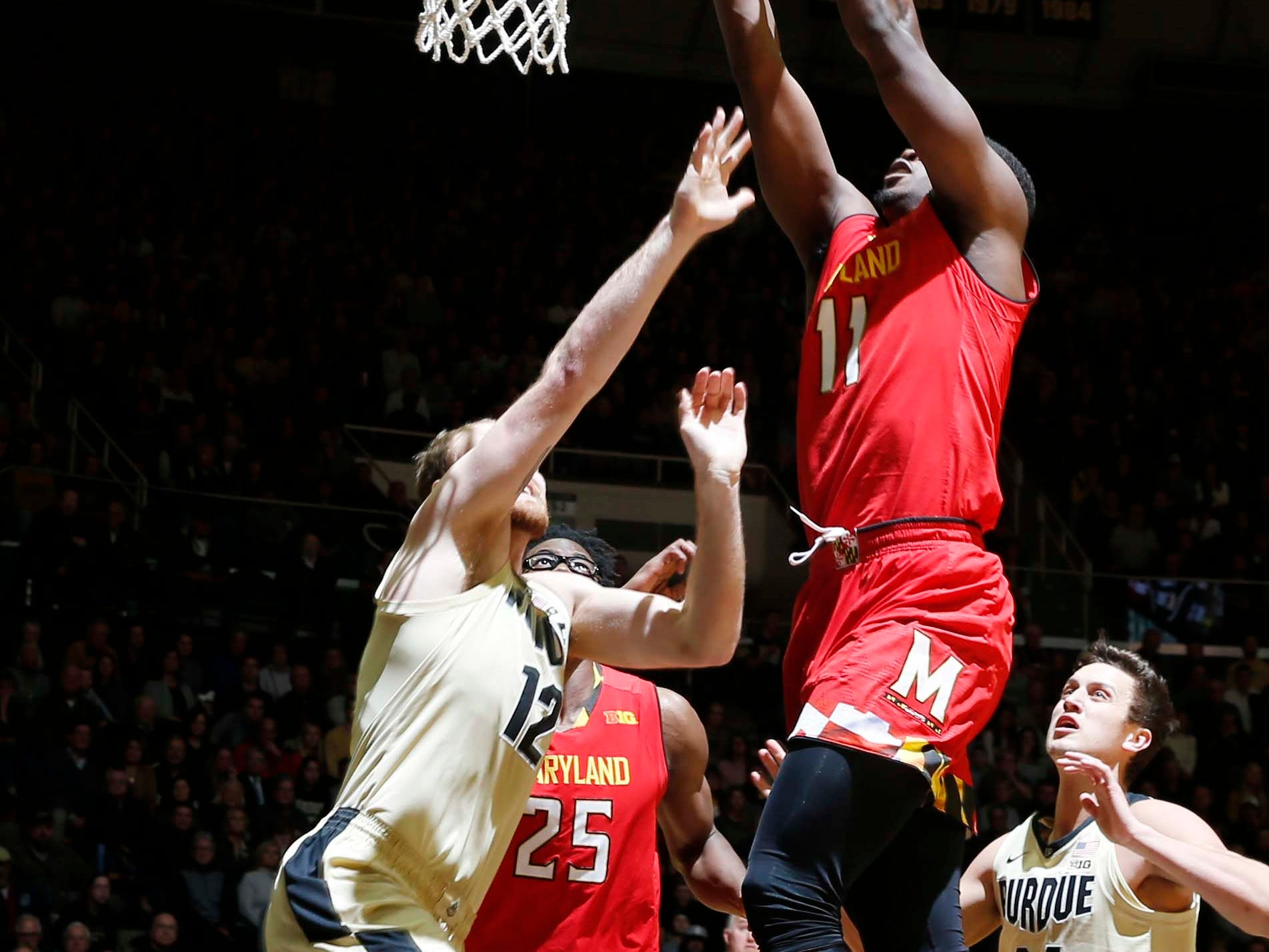 Dec 6, 2018; West Lafayette, IN, USA; Maryland Terrapins guard Darryl Morsell (11) takes a shot against Purdue Boilermakers forward Evan Boudreaux (12) during the first half at Mackey Arena. Mandatory Credit: Brian Spurlock-USA TODAY Sports