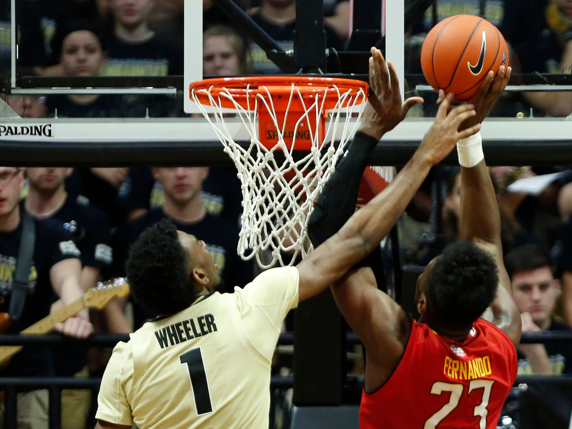 Aaron Wheeler of Purdue tries to block the shot by Bruno Fernando of Maryland Thursday, December 6, 2018, at Mackey Arena. Purdue defeated Maryland 62-60.