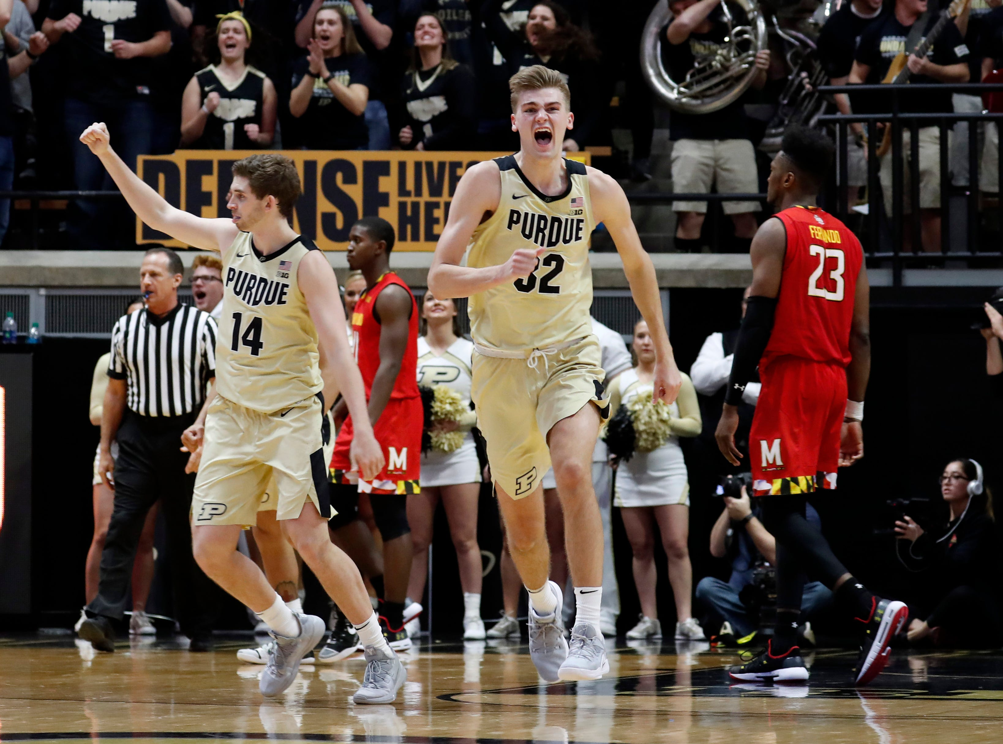 Dec 6, 2018; West Lafayette, IN, USA; Purdue Boilermakers center Matt Haarms (32) and guard Ryan Cline (14) react after the game to Purdue winning against the Maryland Terrapins at Mackey Arena. Mandatory Credit: Brian Spurlock-USA TODAY Sports