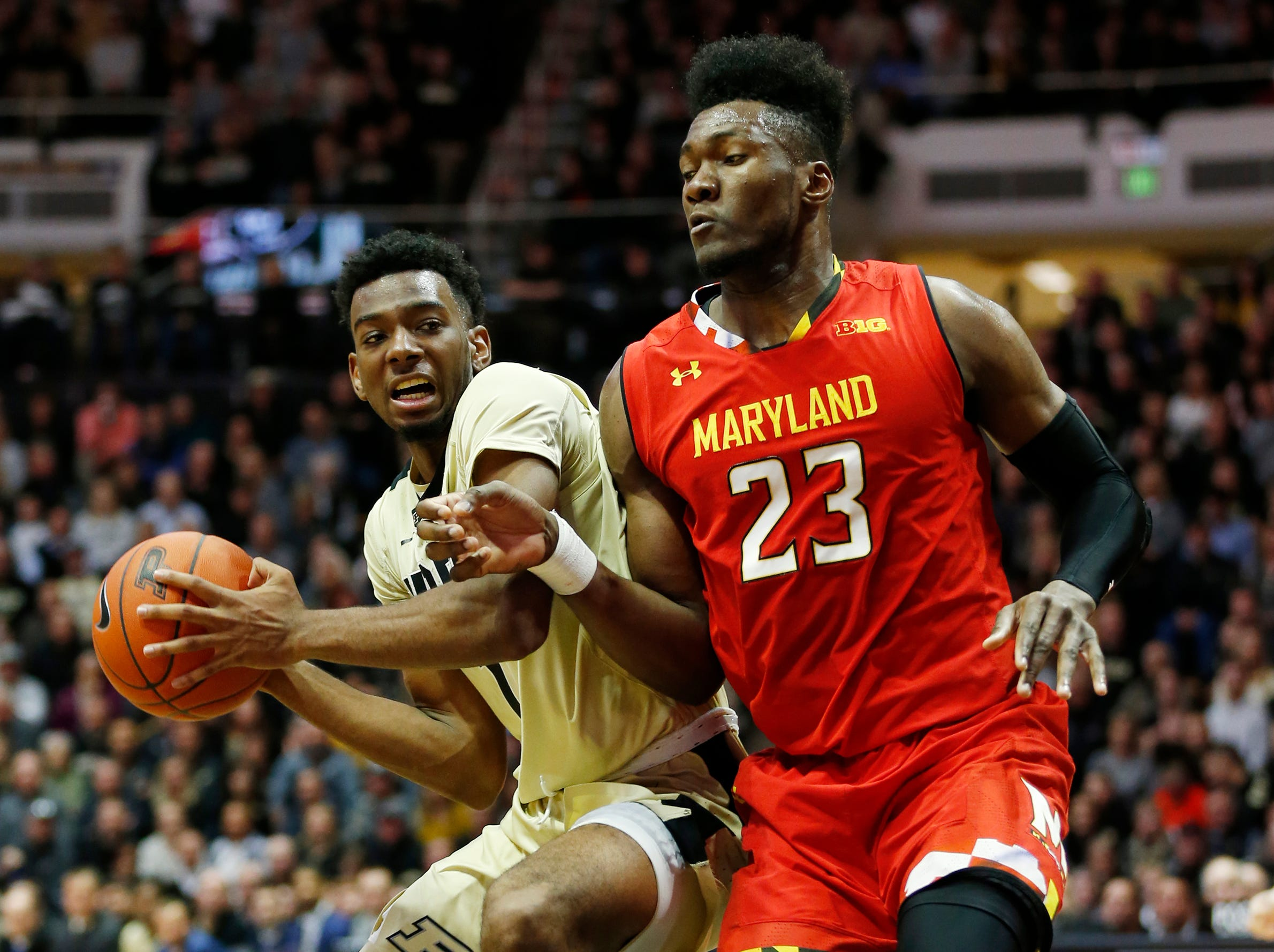 Aaron Wheeler of Purdue works for a shot against Bruno Fernando of Maryland Thursday, December 6, 2018, at Mackey Arena. Purdue defeated Maryland 62-60.