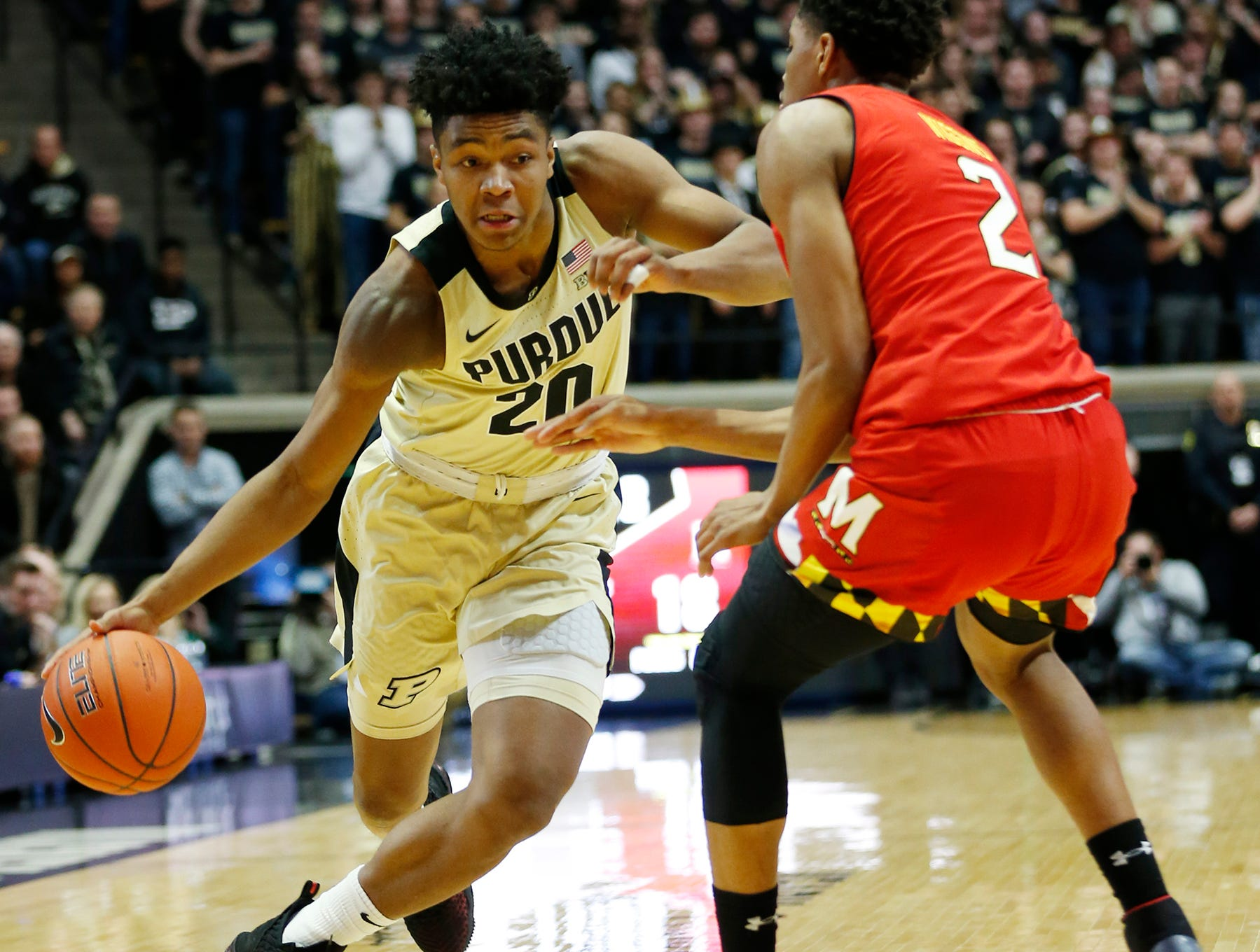 Nojel Eastern of Purdue gets a step on Aaron Wiggins of Maryland Thursday, December 6, 2018, at Mackey Arena. Purdue defeated Maryland 62-60.
