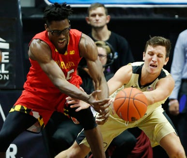 Grady Eifert of Purdue slaps the ball out of the hands of Jalen Smith of Maryland Thursday, December 6, 2018, at Mackey Arena. Purdue defeated Maryland 62-60.