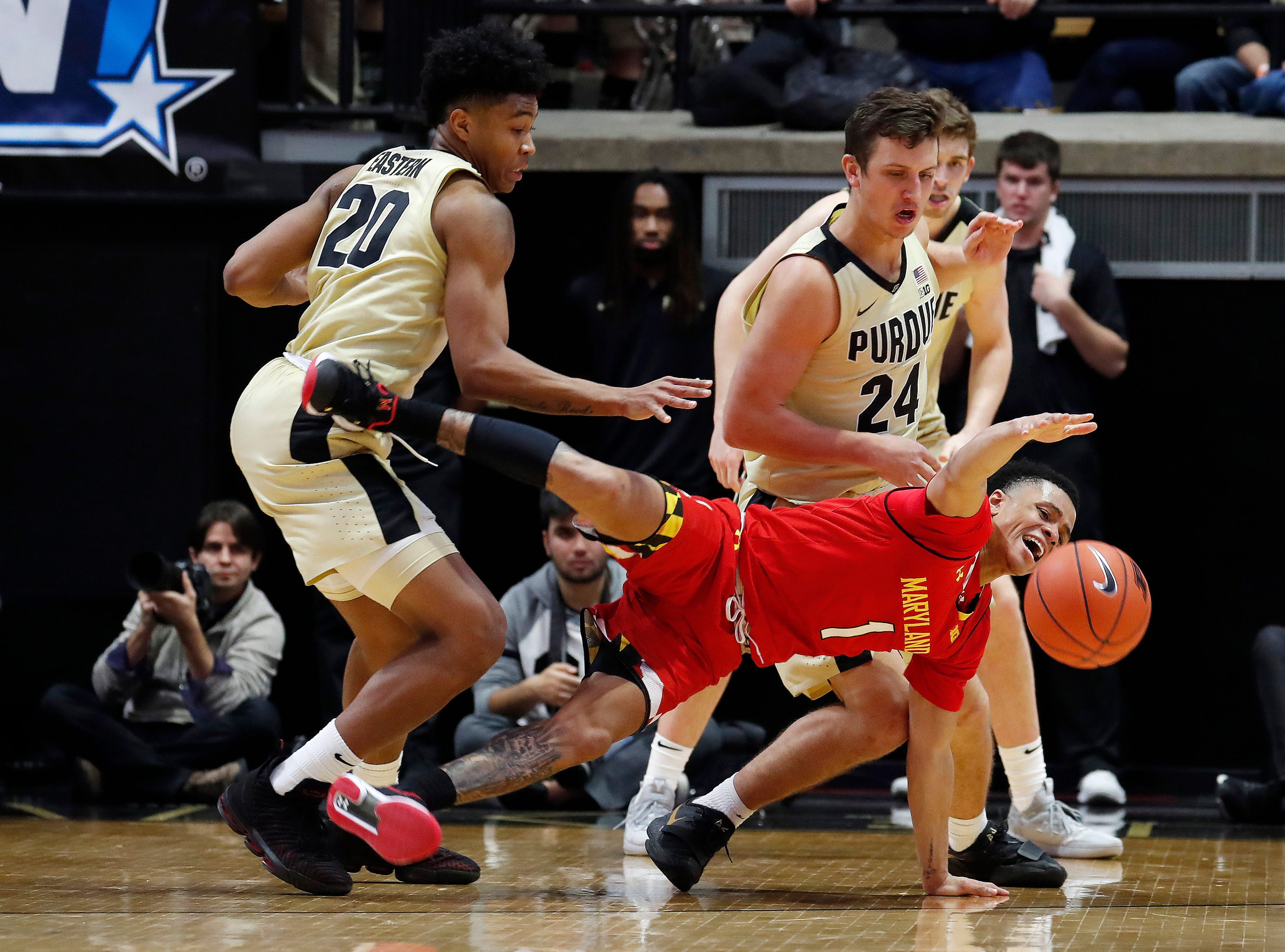 Maryland Terrapins guard Anthony Cowan Jr. (1) scrambles for a loose ball against Purdue Boilermakers forward Grady Eifert (24) during the second half at Mackey Arena.