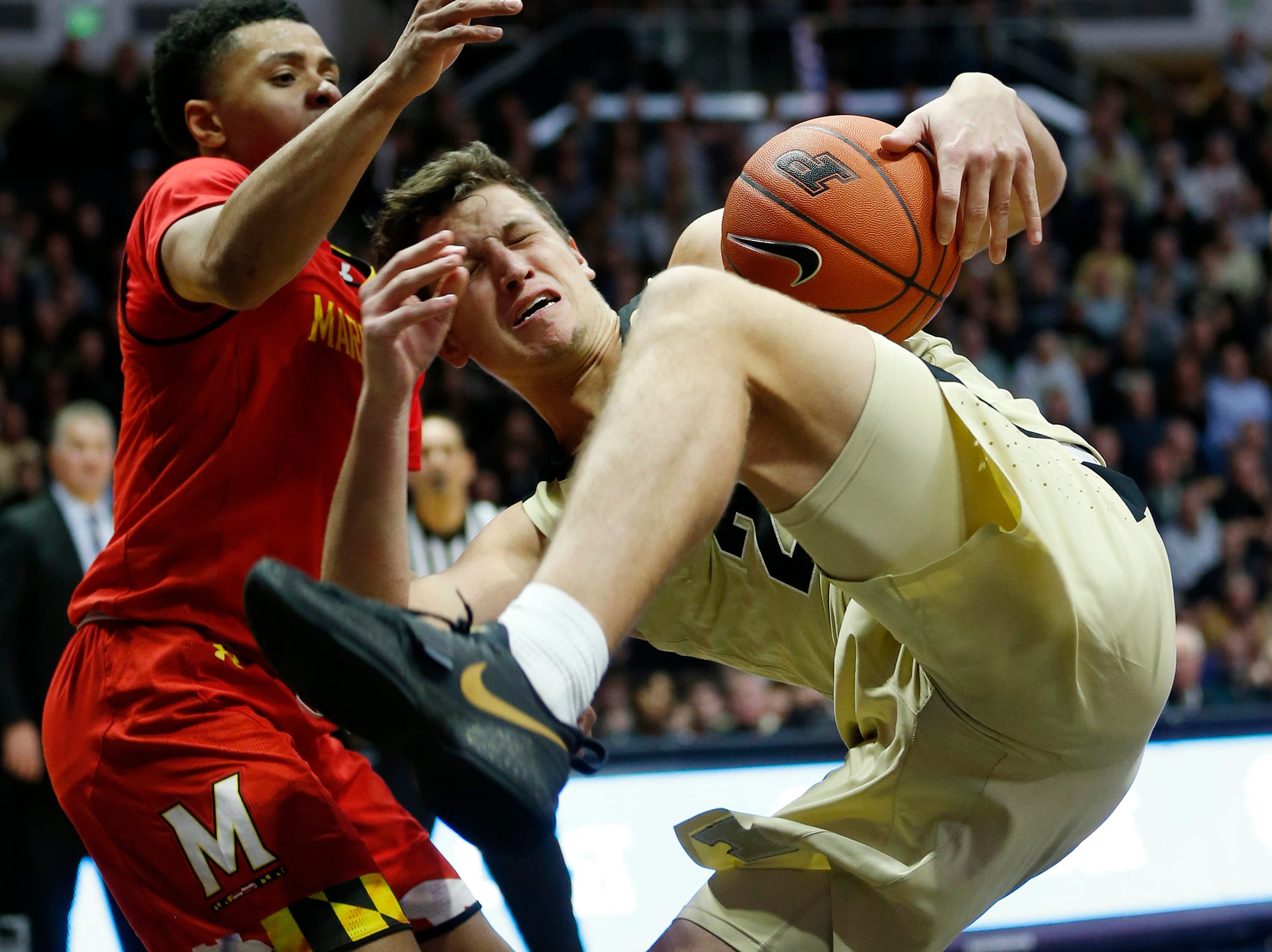 Grady Eifert pulls down an offensive rebound against Maryland Thursday, December 6, 2018, at Mackey Arena. Purdue defeated Maryland 62-60.