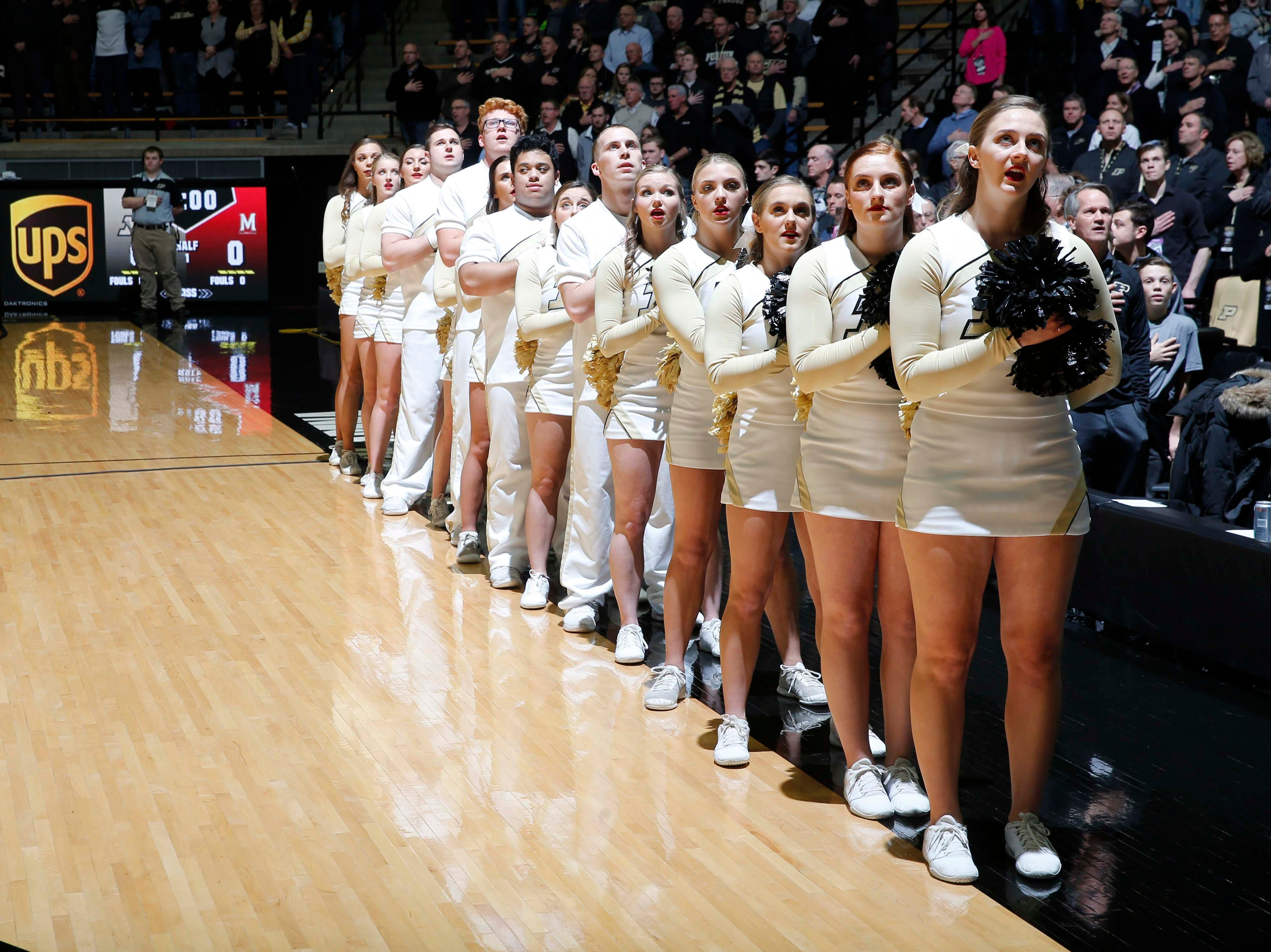 Dec 6, 2018; West Lafayette, IN, USA; Purdue Boilermaker cheerleaders stand at attention during the playing of the National Anthem before the game against the Maryland Terrapins at Mackey Arena. Mandatory Credit: Brian Spurlock-USA TODAY Sports