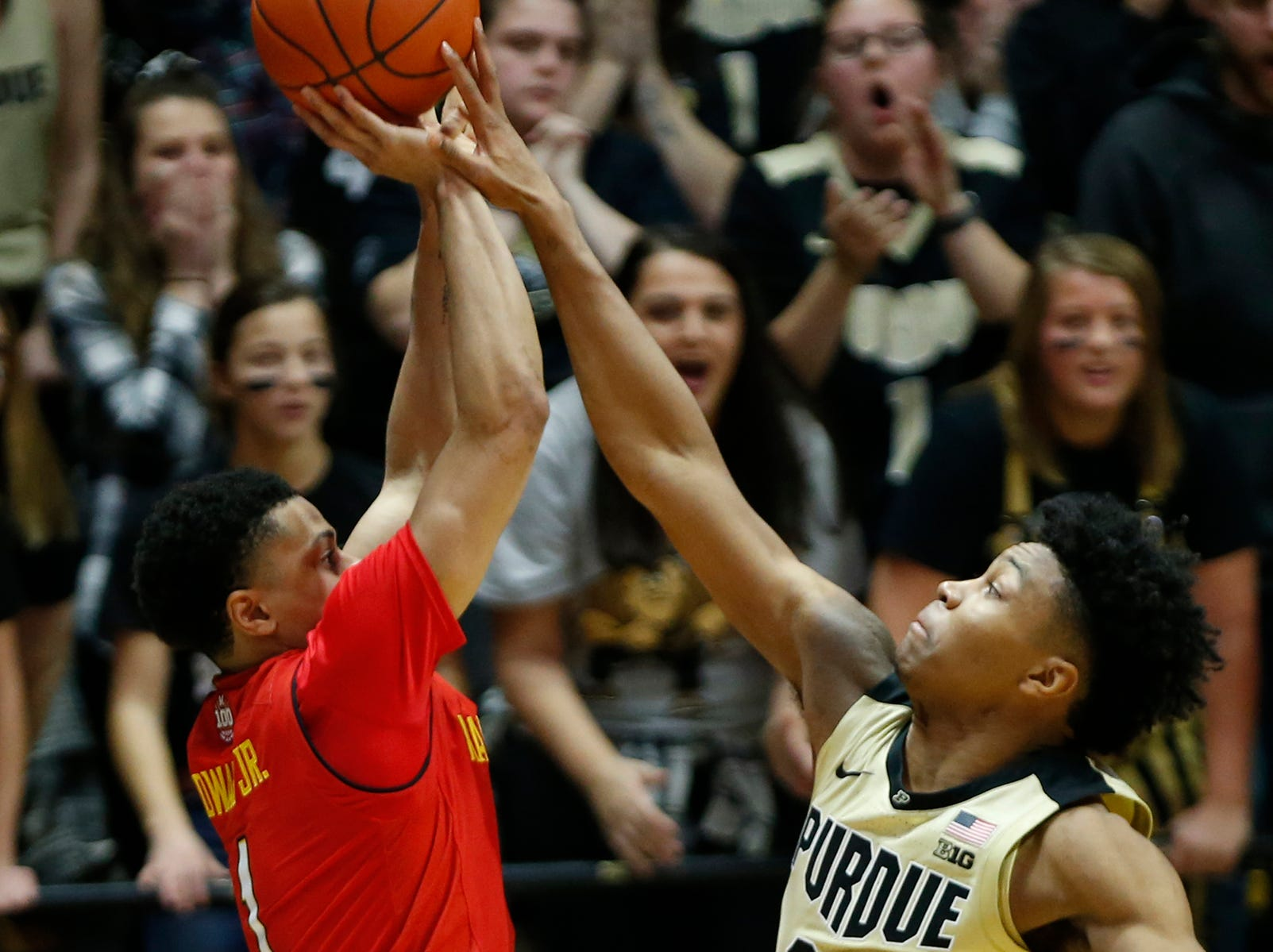 Nojel Eastern of Purdue blocks the shot of Anthony Cowan Jr. of Maryland as time expires Thursday, December 6, 2018, at Mackey Arena. Purdue defeated Maryland 62-60.